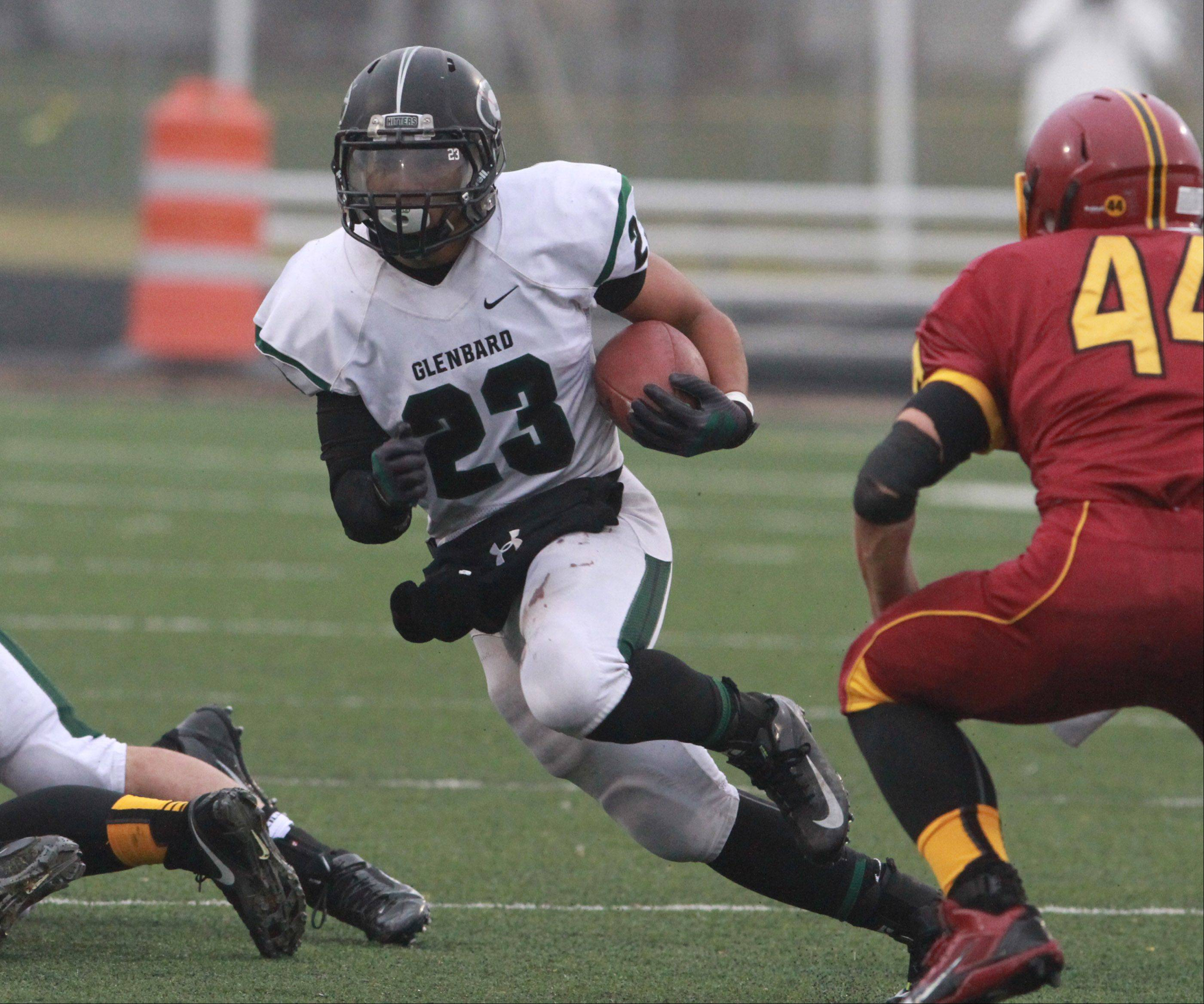 Glenbard West running back Scott Andrews runs the ball against Schaumburg.