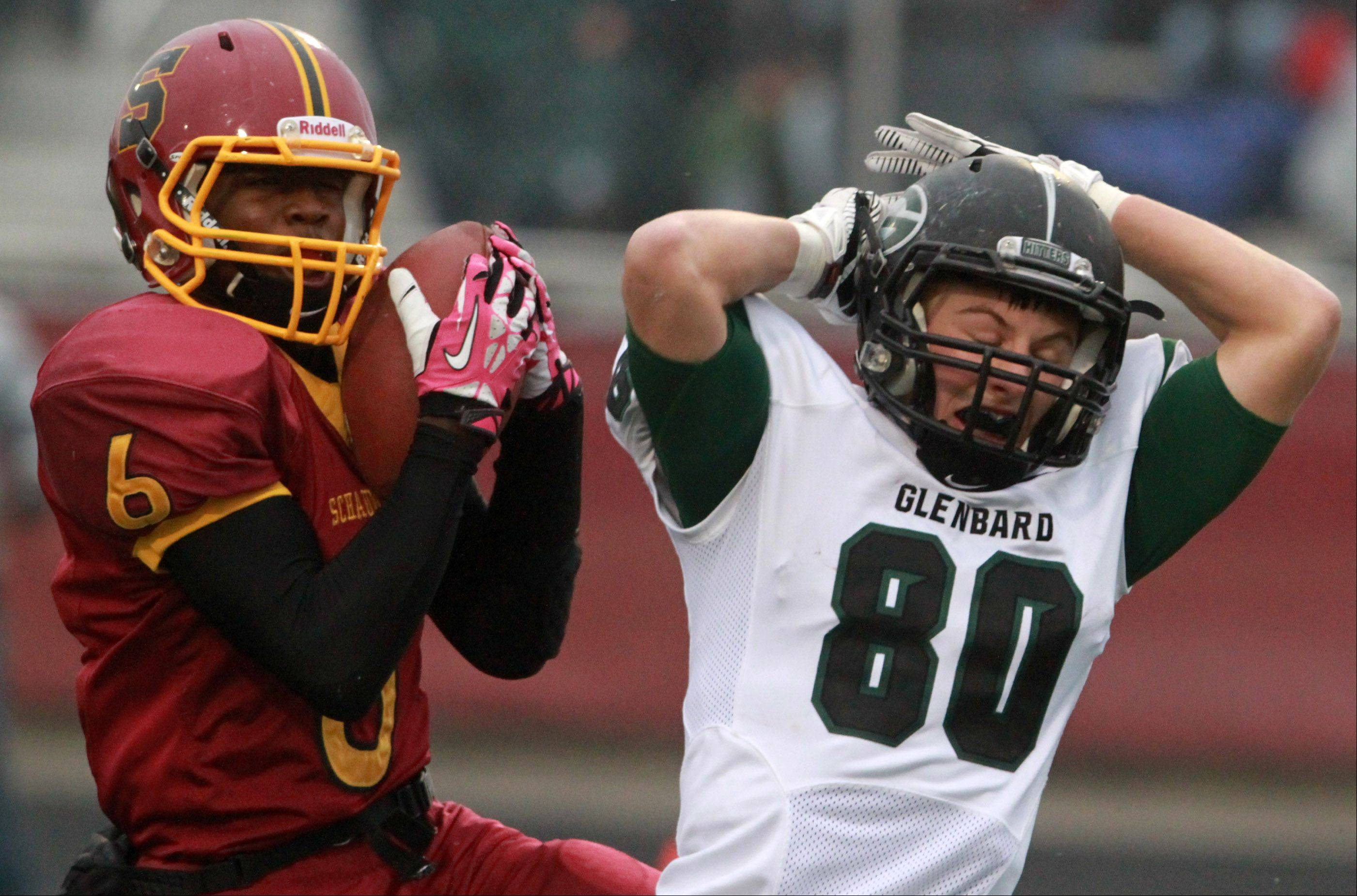 Schaumburg defensive back Shandall Thomas intercepts a pass intended for Glenbard West wide receiver Luke Damask.