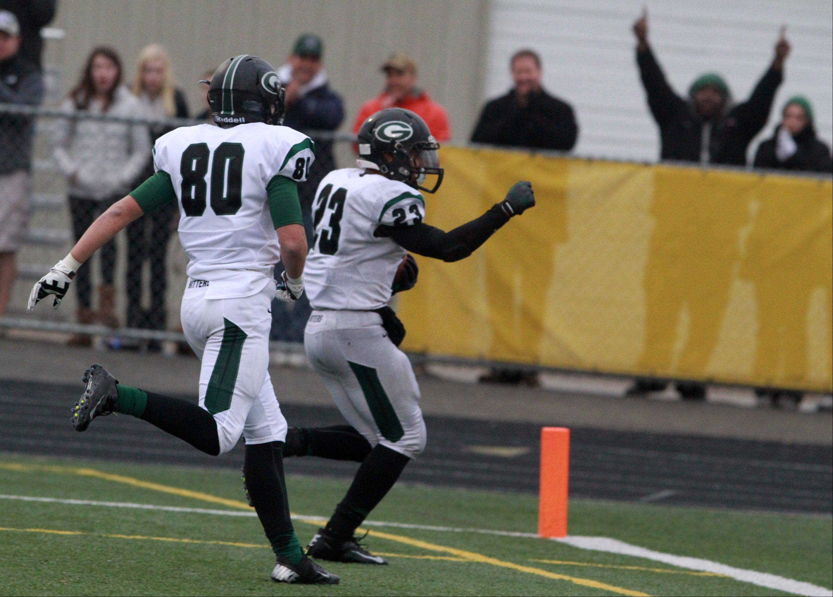 Glenbard West running back Scott Andrews celebrates running for a touchdown against Schaumburg in a quarterfinal playoff game on Saturday, November 16th, in Schaumburg.