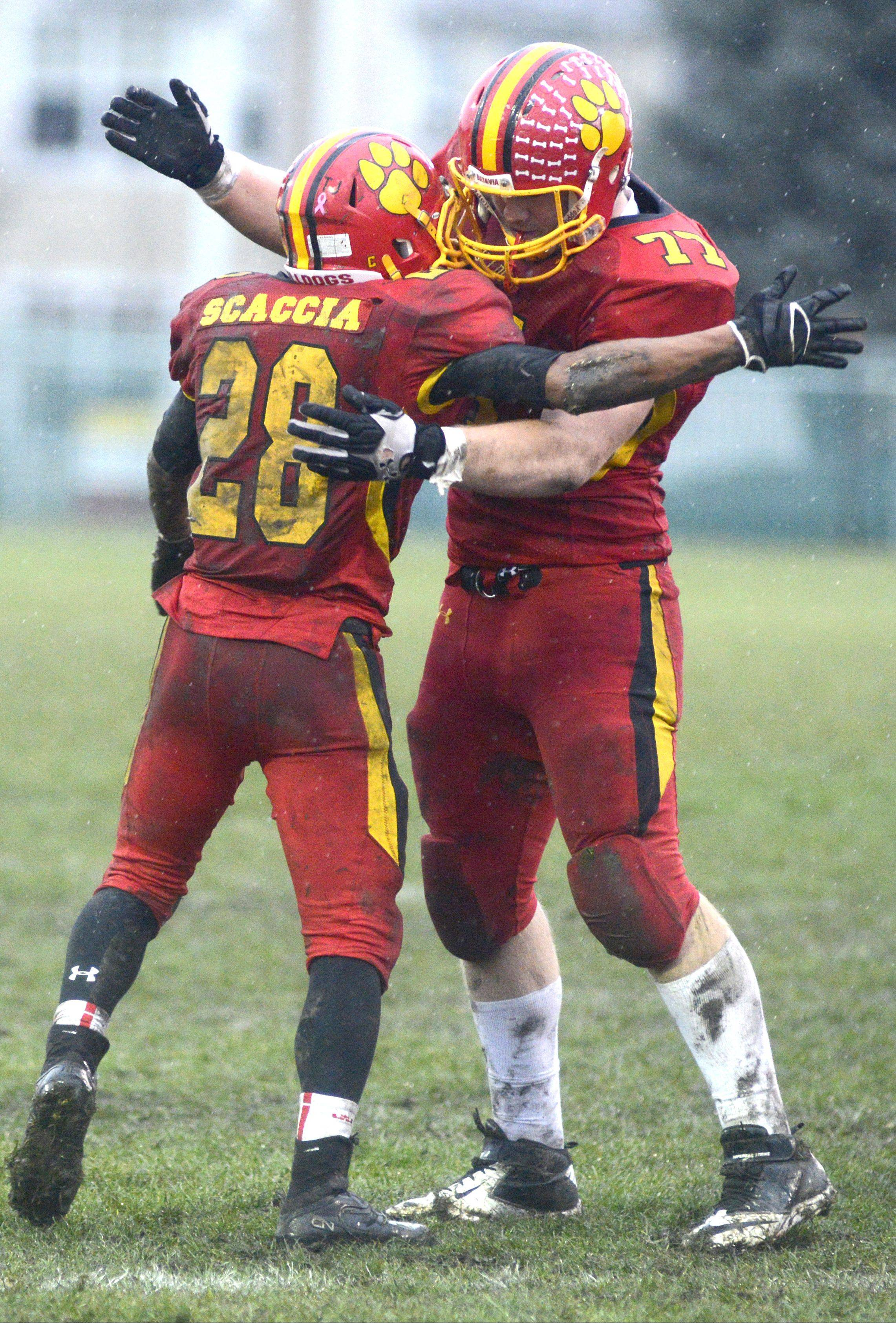 Batavia's Anthony Scaccia and Jack Breshears embrace on the field as the seconds tick down in their victory over Lake Forest in the Class 6A quarterfinals last week.