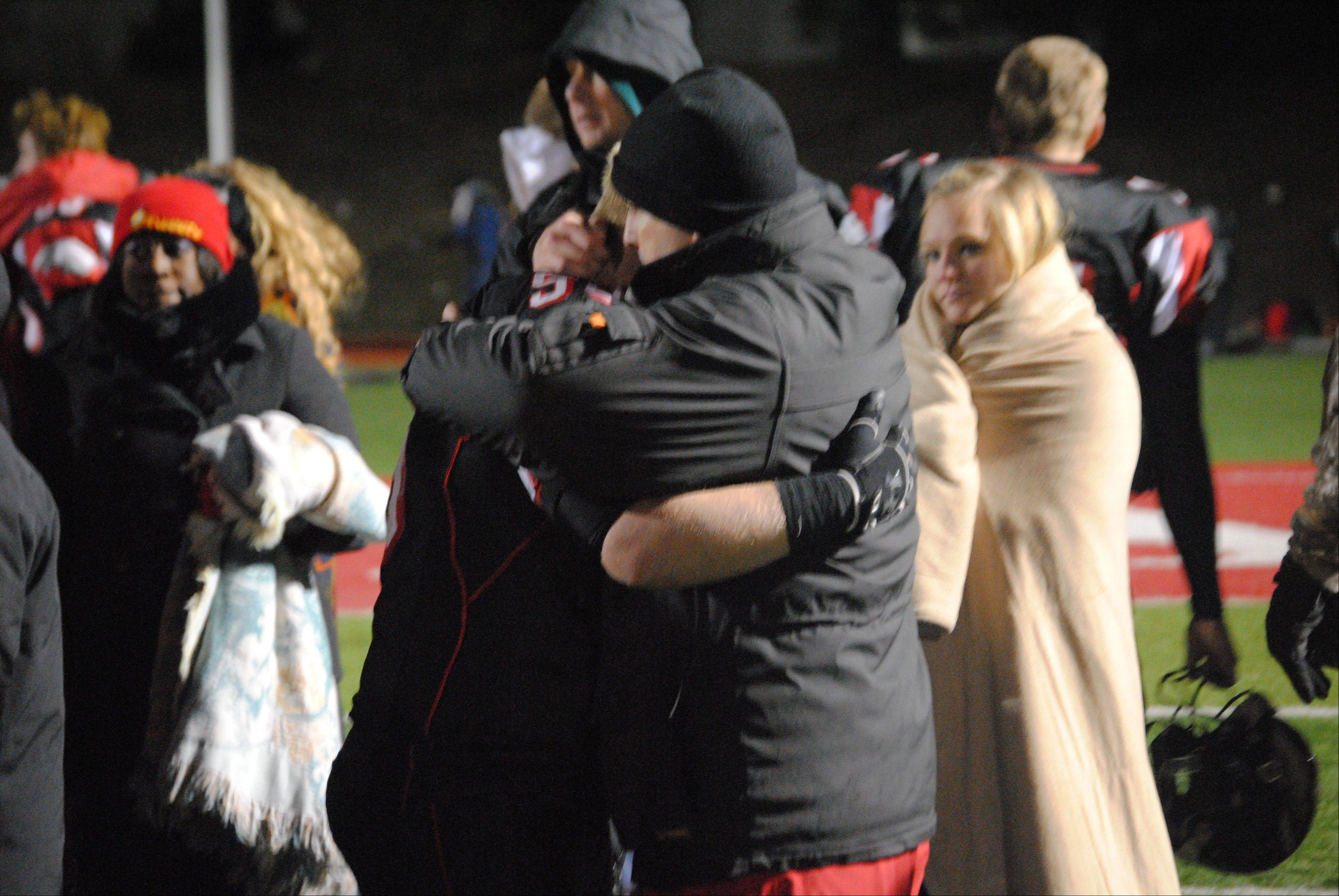 Aurora Christian senior center Tristin Withrow is consoled by an assistant coach moments after the Eagles' 28-26 Class 3A state semifinal loss to Stillman Valley Saturday in Aurora.