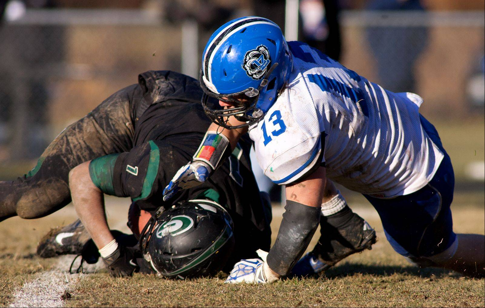 Lake Zurich defensive end Chris Lehtinen makes a tackle during Saturday's Class 7A state semifinal at Glenbard West.