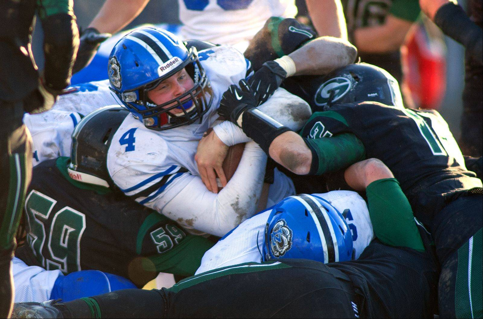Lake Zurich quarterback Noah Allgood ices the game late in the fourth quarter as he dives over the goal line for a touchdown against Glenbard West.