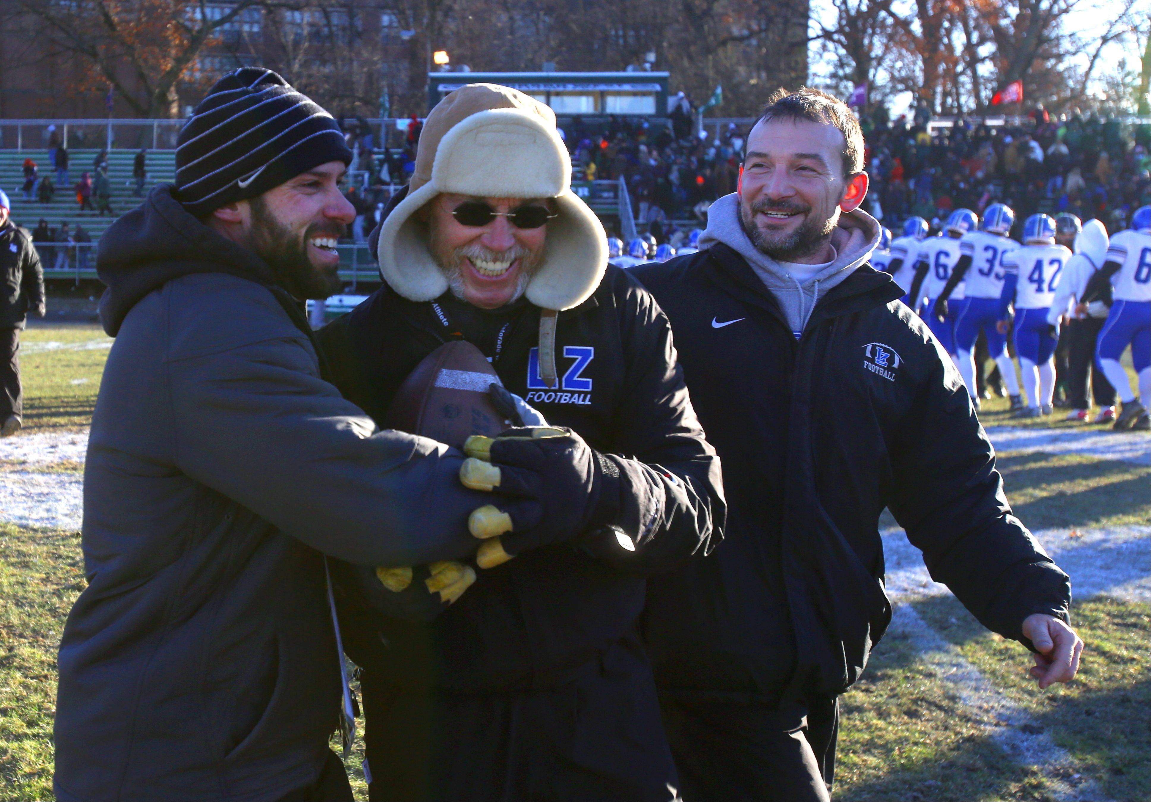 Lake Zurich coaching staff celebrates a 16-7 win over Glenbard West during the Class 7A Semifinal Football Playoffs in Glen Ellyn.