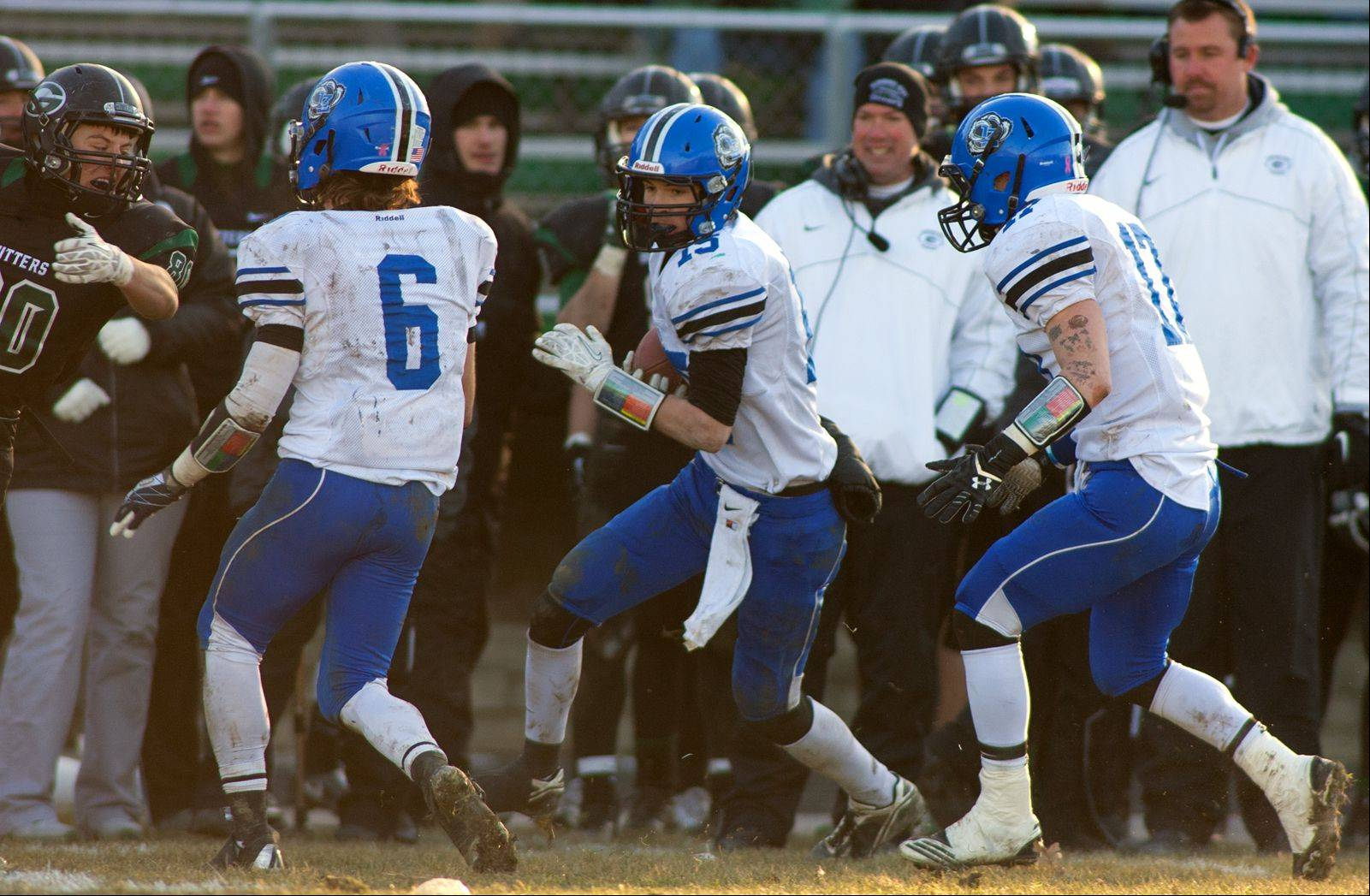 Lake Zurich's Trevor Staley, center, looks for yardage after his fourth quarter interception set up the final Bears touchdown over Glenbard West.
