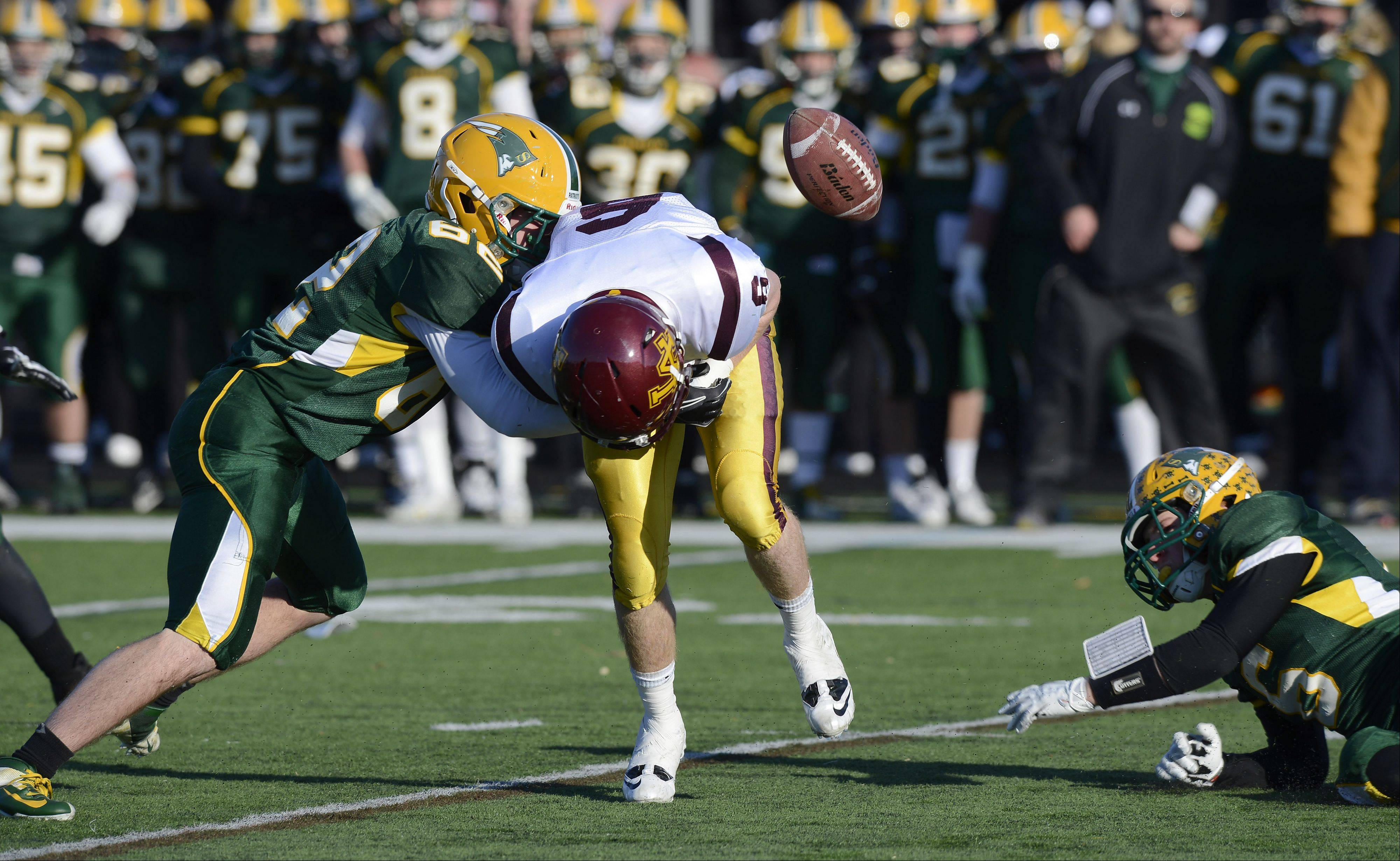 Stevenson's Tyler Harrington, left, and Itai Gerchikov force a fumble by Loyola's Fran O'Malley during Saturday's class 8A semifinal in Lincolnshire.