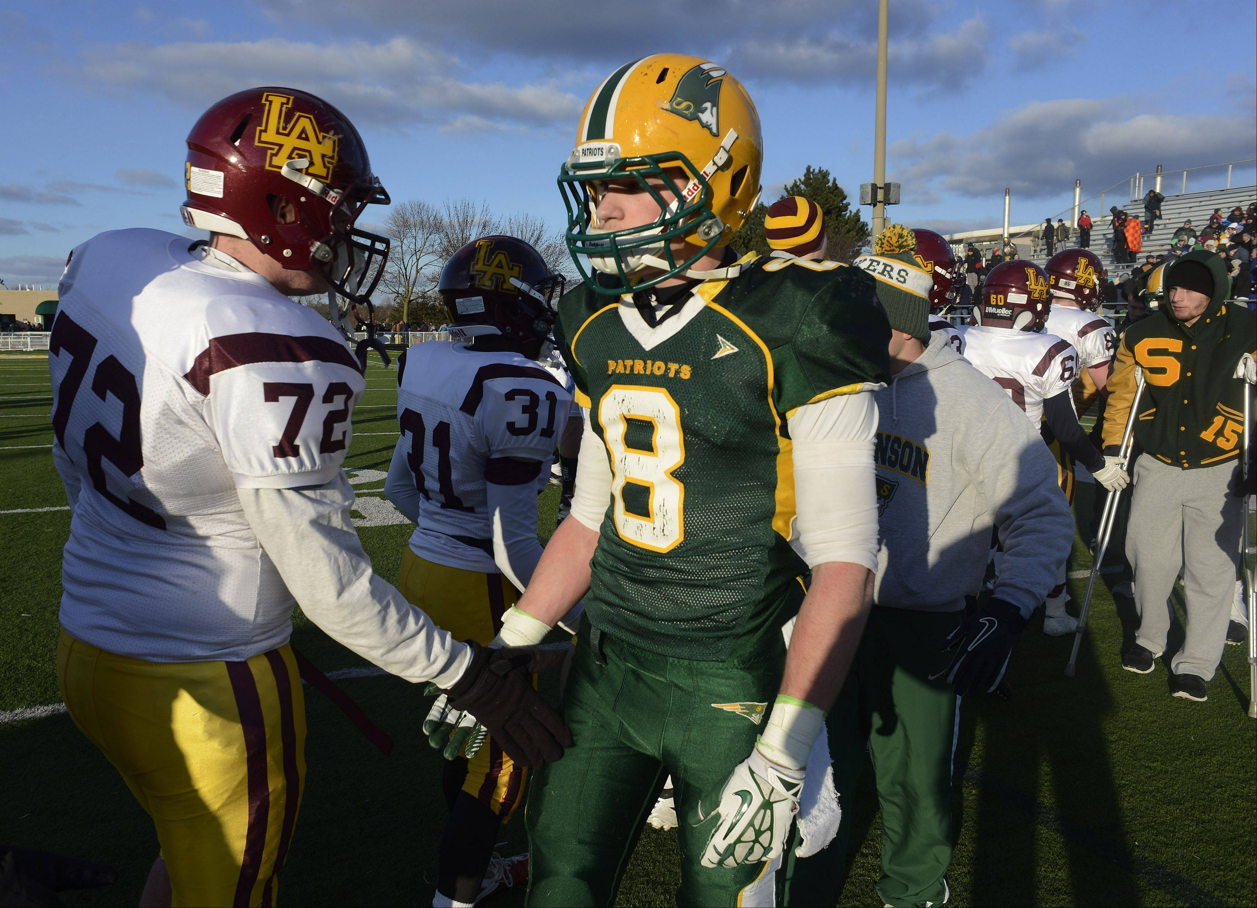 Stevenson's Matt Morrissey, right, shakes hands with Loyola players including Jack Kotowski following the Patriots' 15-14 loss during Saturday's class 8A semifinal in Lincolnshire.