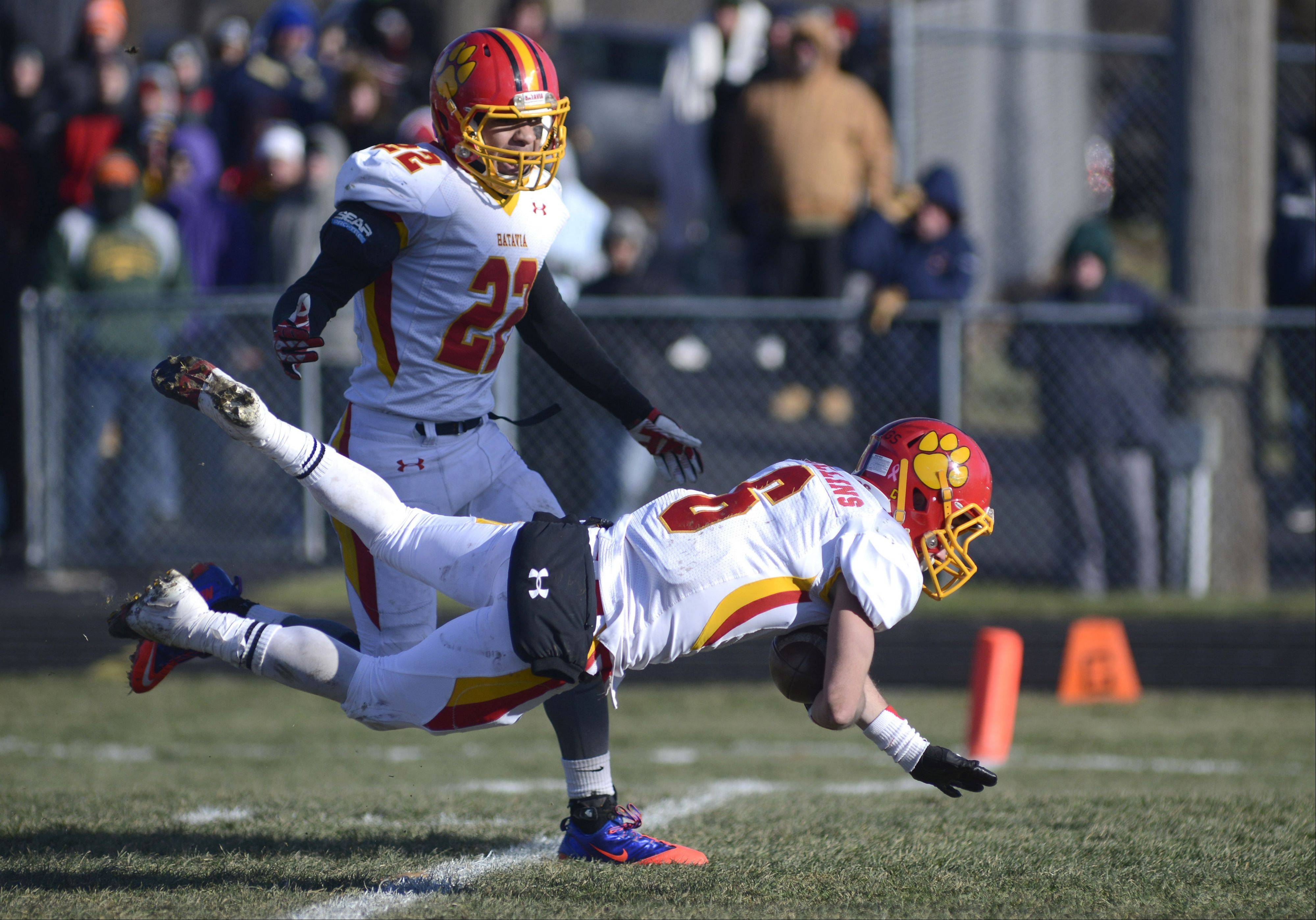 Batavia's Rourke Mullins soars over the goal line past teammate Anthony Thielk after intercepting a Rockford Boylan pass and making a successful run for the end zone in the second quarter of the Class 6A semifinal game on Saturday, November 23.
