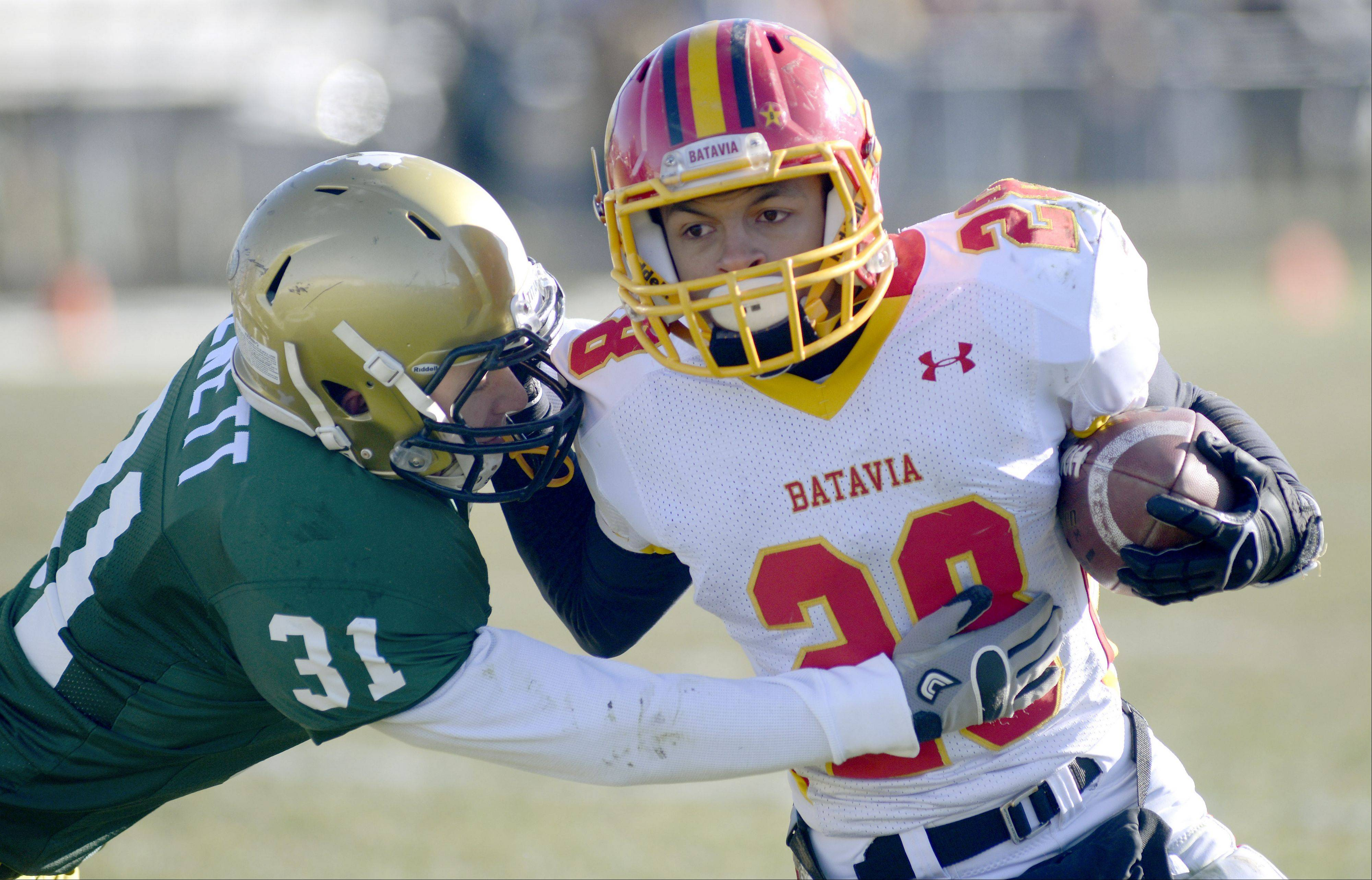 Batavia's Anthony Scaccia pushes off at attempted tackle by Rockford Boylan's Steven Hewett in the first quarter of the Class 6A semifinal game on Saturday, November 23.