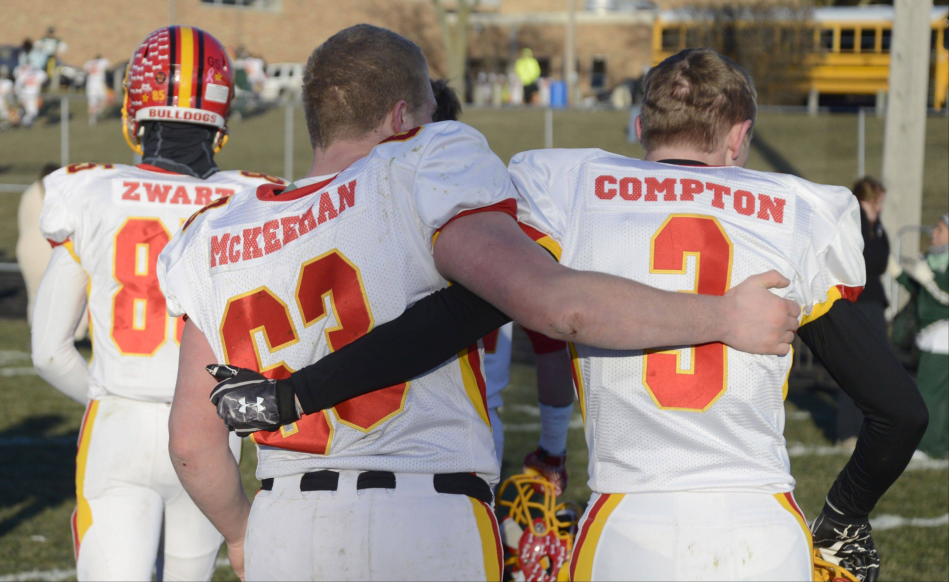Batavia seniors Connor McKeehan and Ethan Compton walk off the field arm in arm after their Class 6A semifinal win over Rockford Boylan on Saturday, November 23.