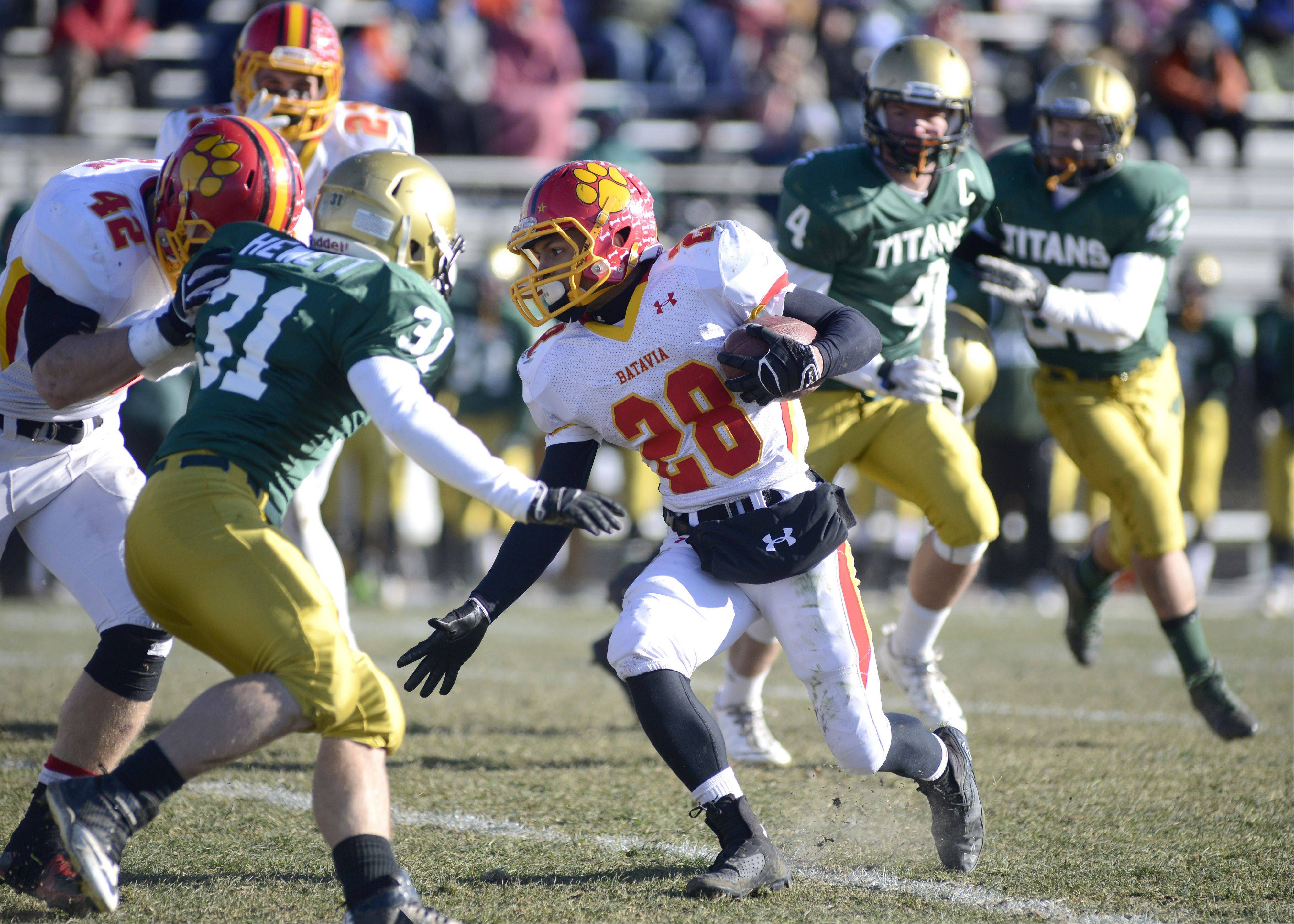 Batavia's Anthony Scaccia looks for a pocket around Rockford Boylan's Steven Hewett as teammate Kevin Green pushes him out of his way in the first quarter of the Class 6A semifinal game on Saturday, November 23.