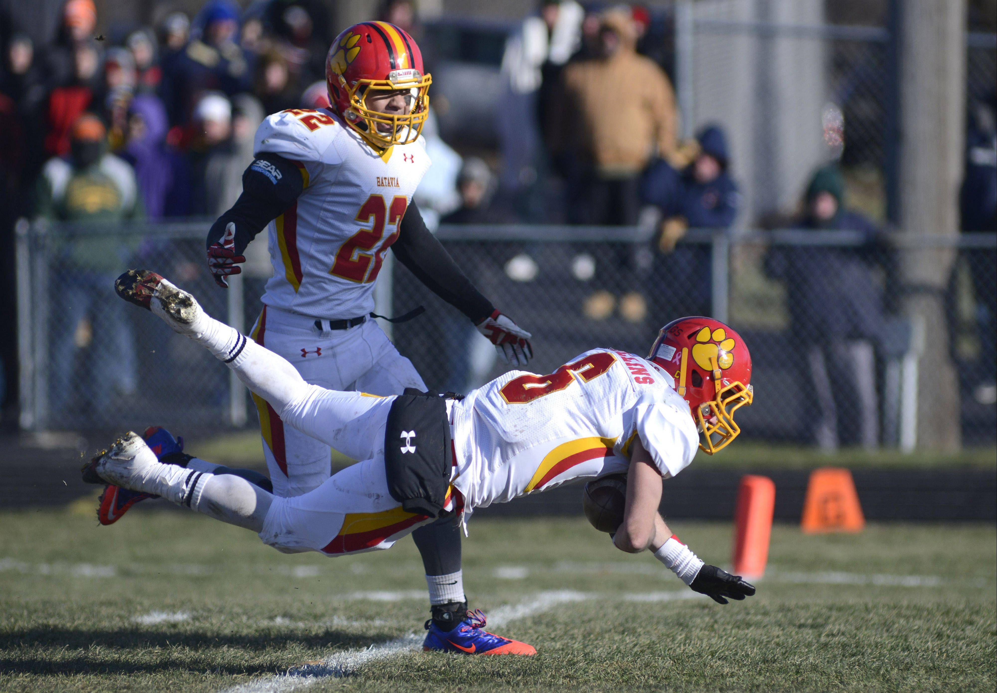 Batavia's Rourke Mullins dives over the goal line past teammate Anthony Thielk after intercepting a Rockford Boylan pass and returning it for a touchdown in the second quarter of the Class 6A semifinal win on Saturday in Rockford.
