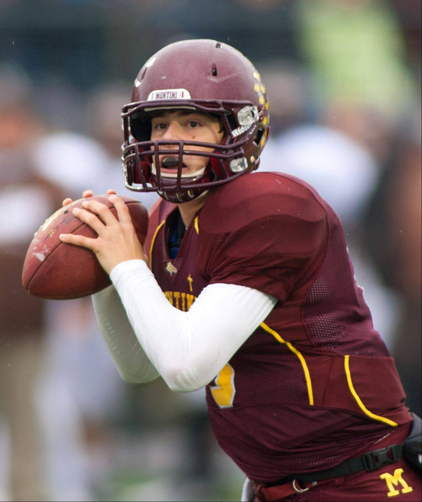 Montini Catholic quarterback Alexander Wills looks to the end zone against Joliet Catholic.