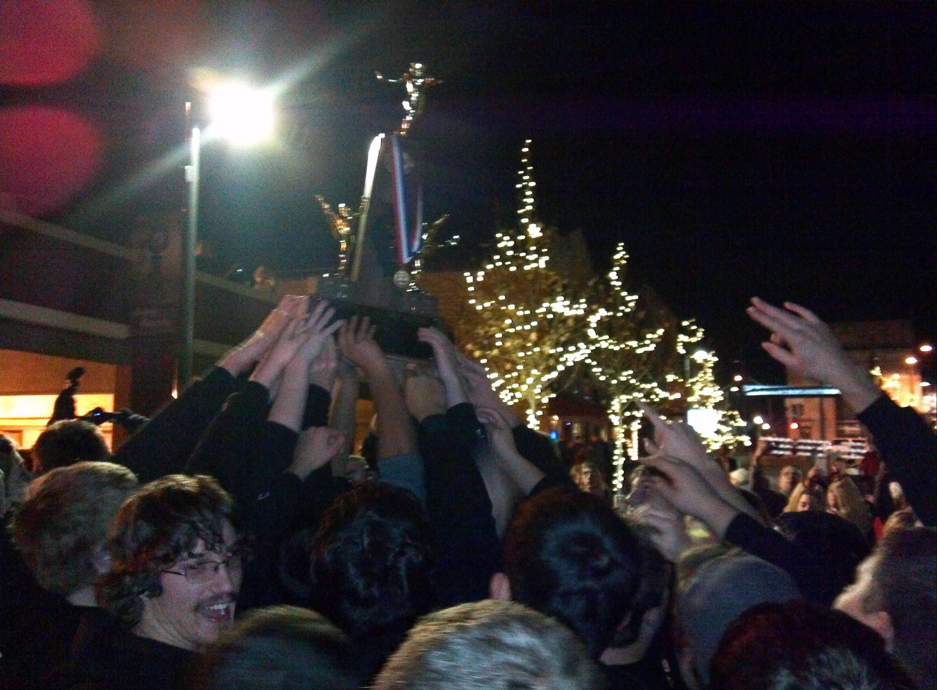 Members of the Batavia High School football team brought the state championship trophy to a street party in downtown Batavia Saturday night. The title, the first for the football program, is the second in school history.