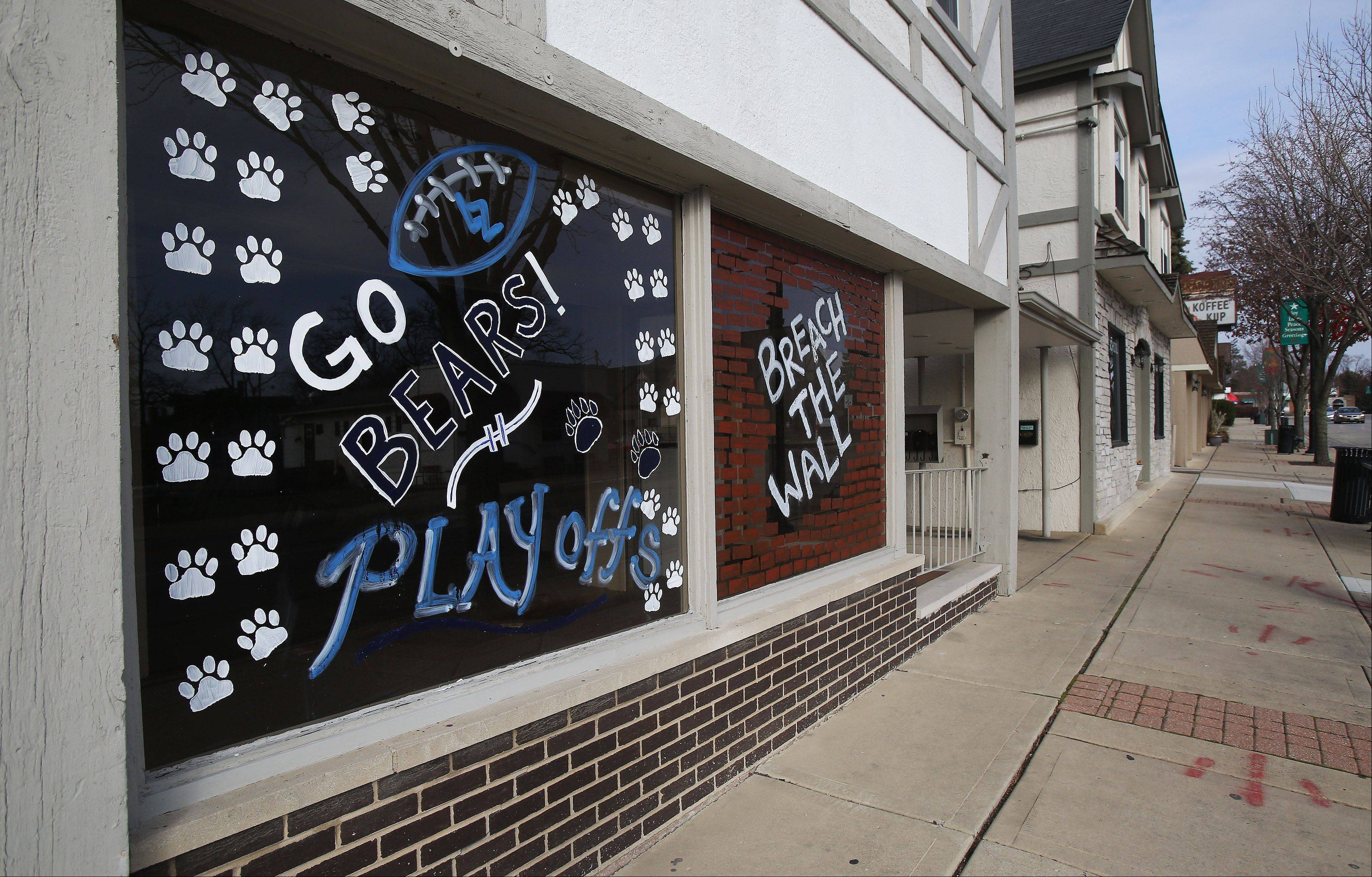 Residents and businesses show support for Lake Zurich High School's football team, which plays for the Class 7A state championship today in DeKalb.