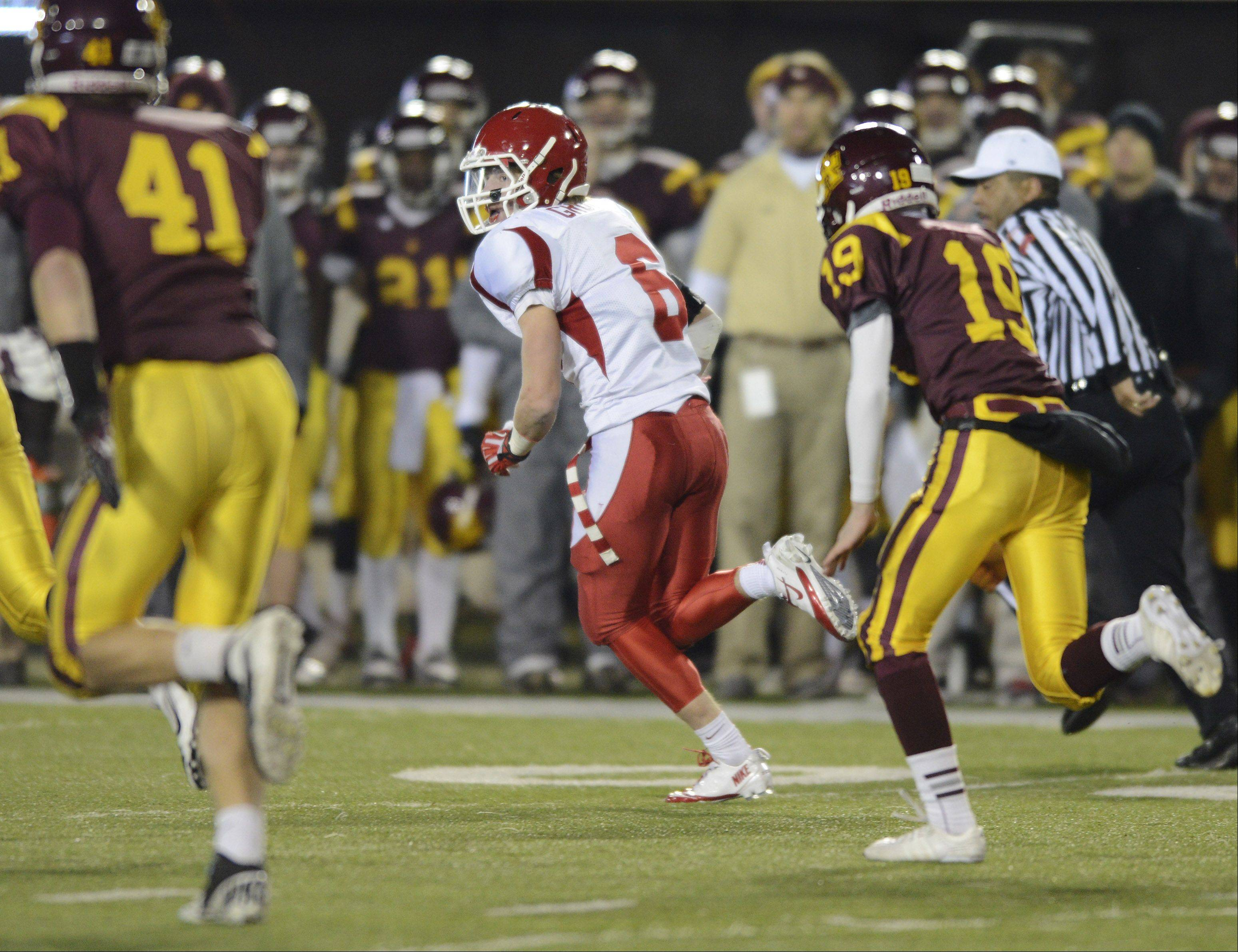Naperville Central's Dillion Grooss runs a blocked field goal for a touchdown against Loyola during the class 8A football final in DeKalb Saturday.