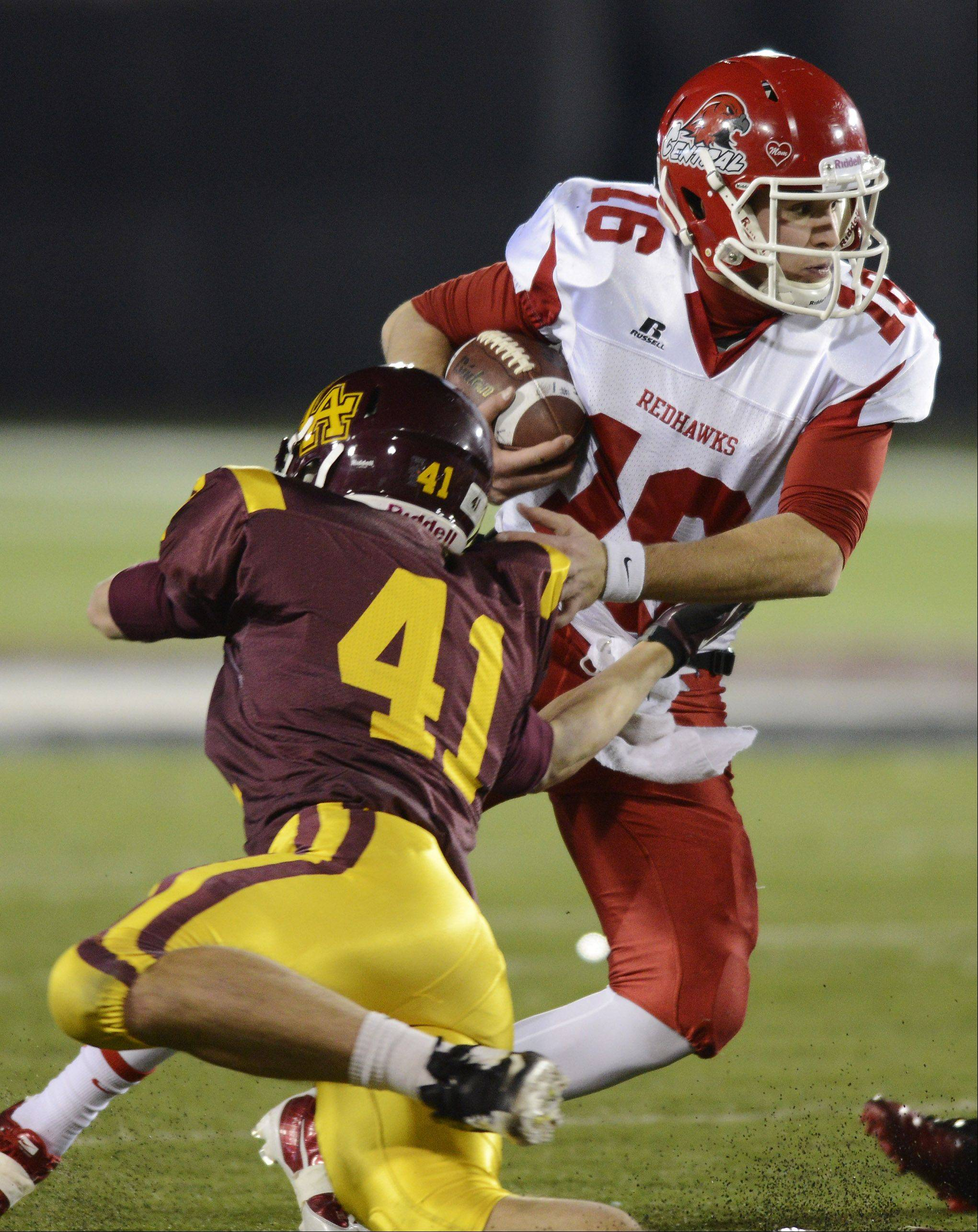 Naperville Central quarterback Jacob Kolbe escapes Loyola's Austin Lyons during the class 8A football final in DeKalb Saturday.