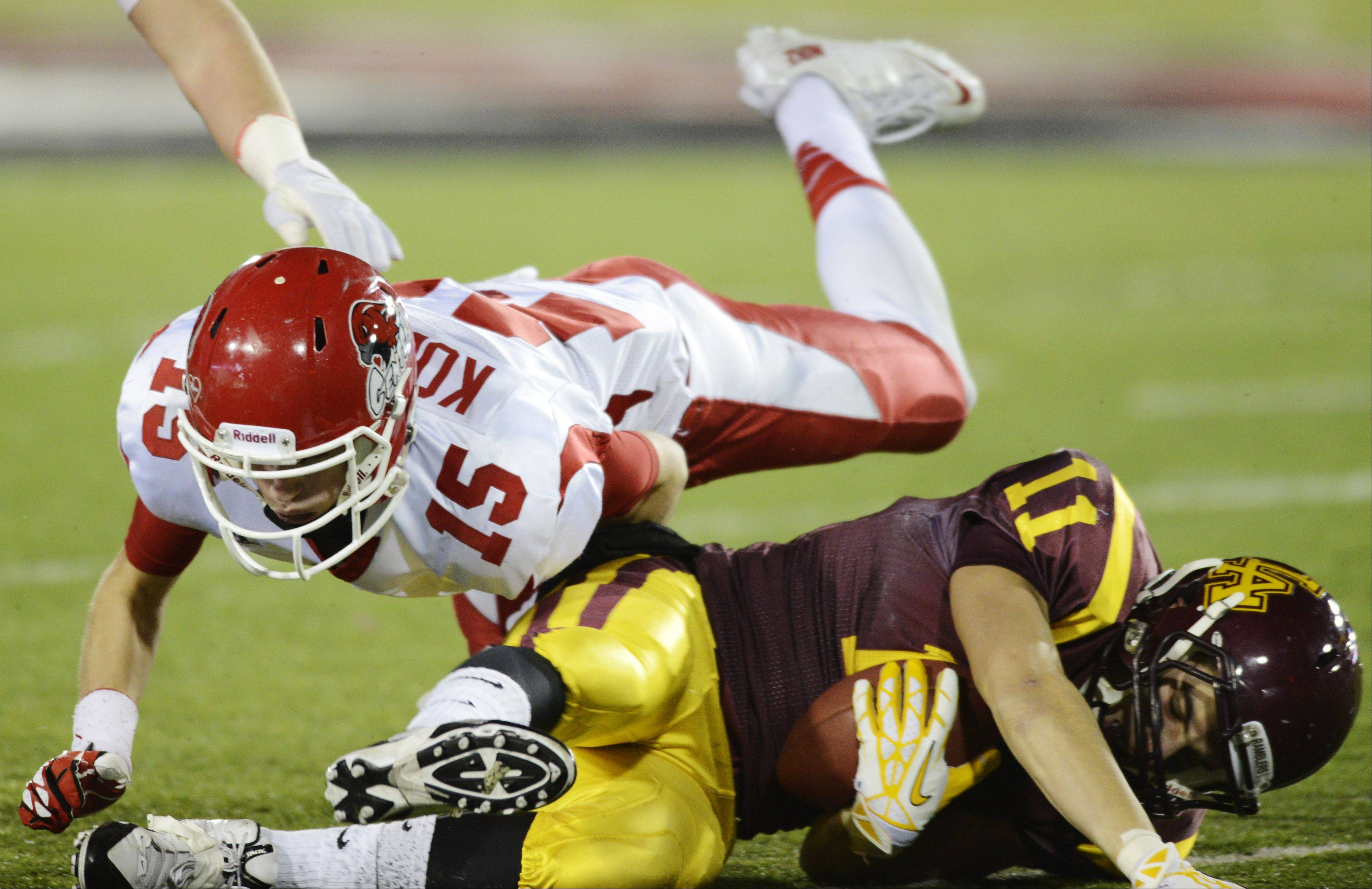 Naperville Central's Michael Kolzow tackles Loyola's Joe Joyce during the class 8A football final in DeKalb Saturday.