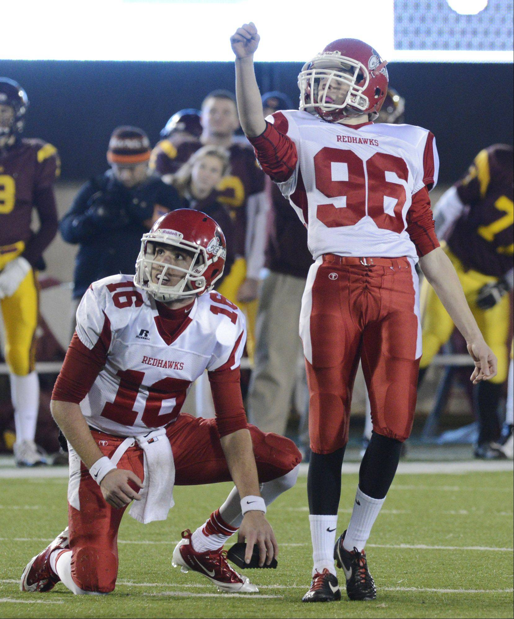 Naperville Central's Connor Assalley and holder Jacob Kolbe watch the flight of their team's first-quarter field goal during the class 8A football final in DeKalb Saturday.
