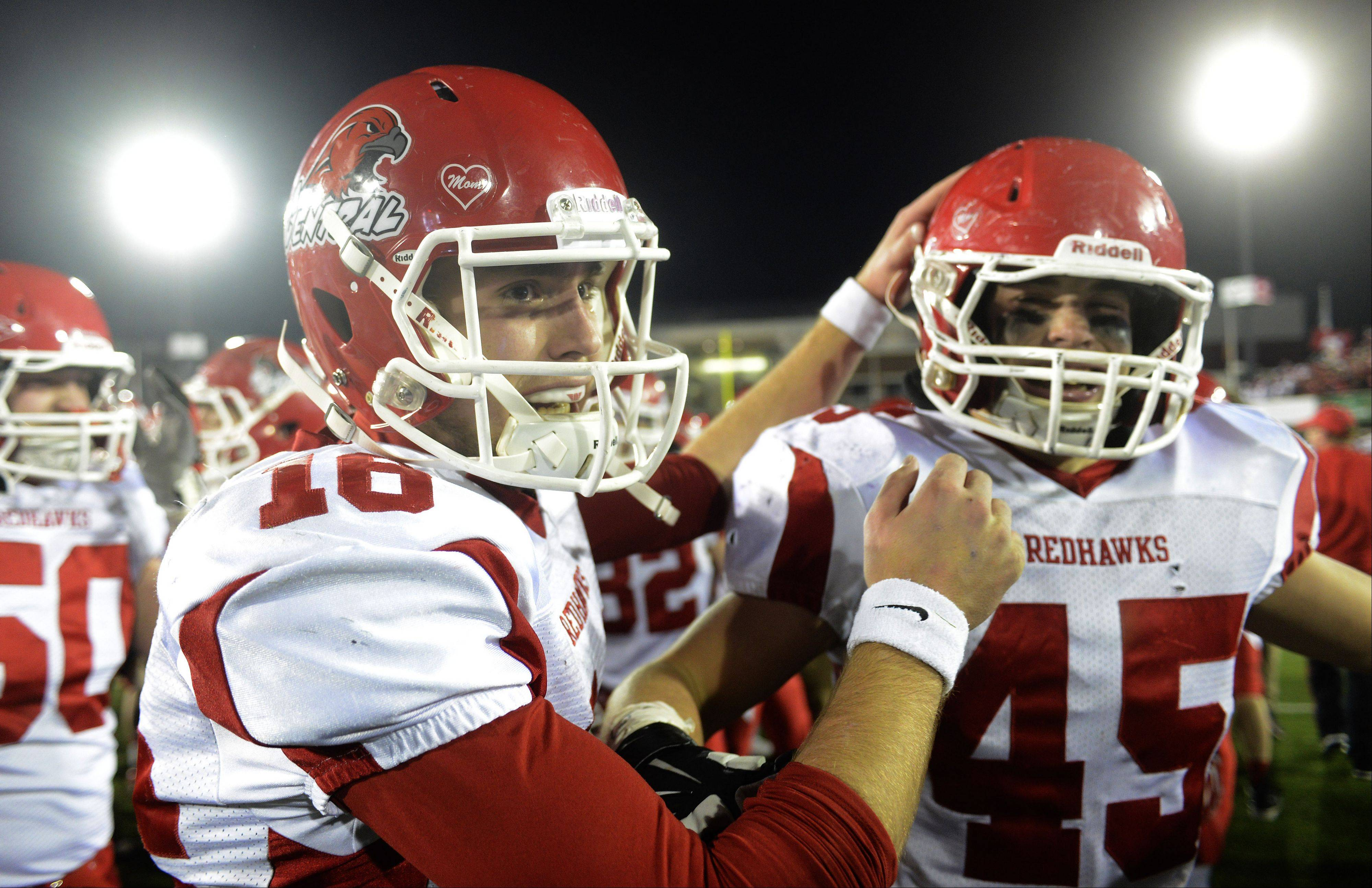 Naperville Central's Kyle Kolbe, left, and Jack Woolridge celebrate their team's victory over Loyola during the class 8A football final in DeKalb Saturday.
