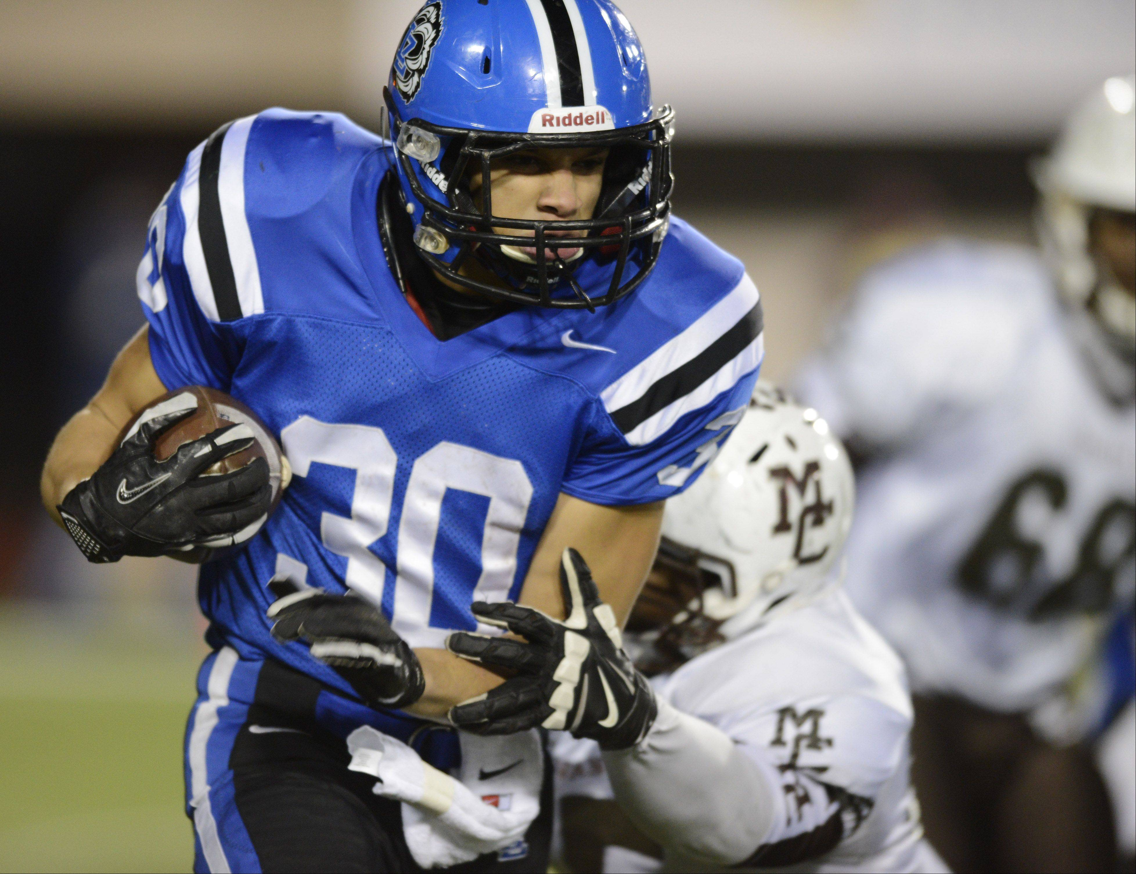 Lake Zurich's Ben Klett carries the ball against Mt. Carmel during the Class 7A football final in DeKalb Saturday.
