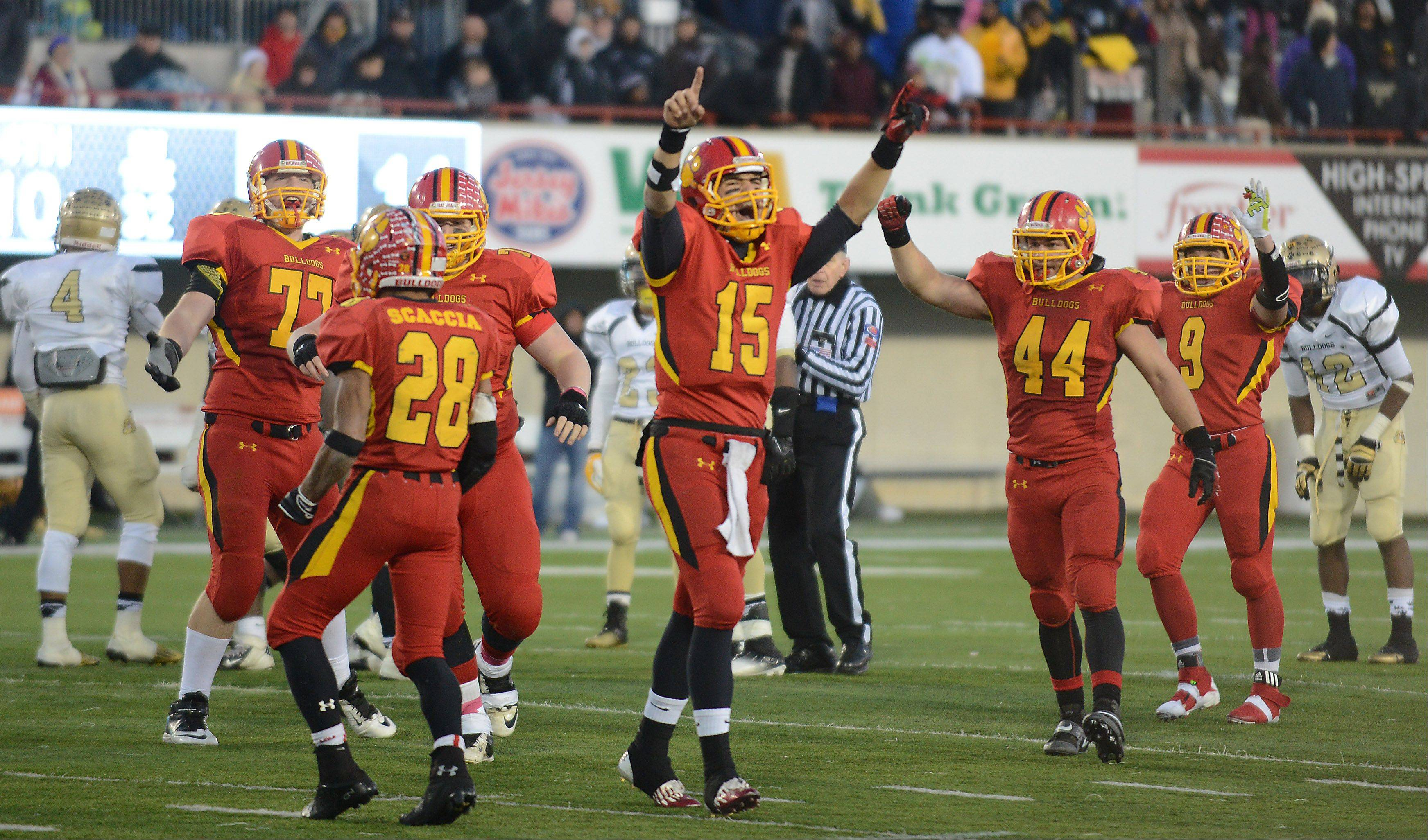 Batavia's Micah Coffey (15) and the offense celebrate as the final second ticks off the clock and they win the 6A championship game Saturday in DeKalb.