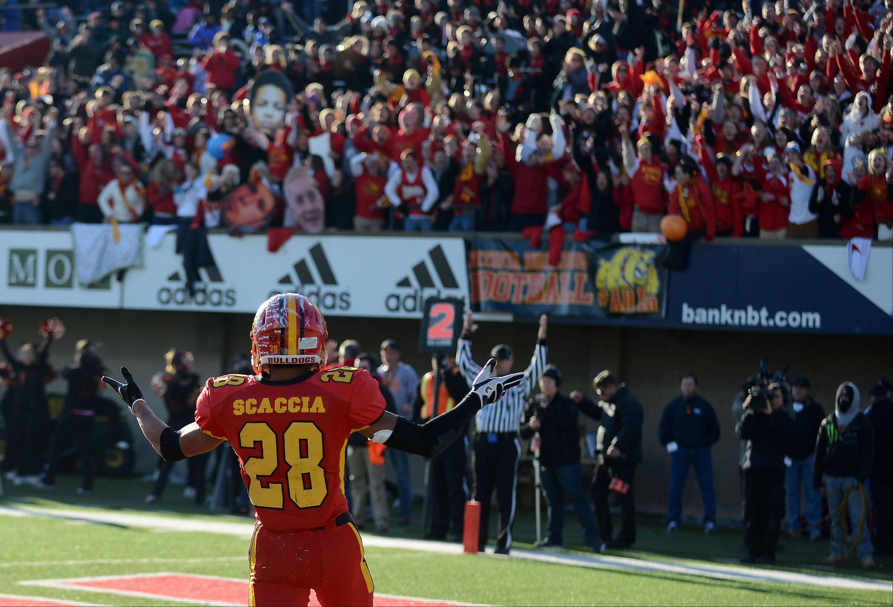 Batavia's Anthony Scaccia (28) plays to the crowd after scoring a first quarter touchdown against Richards during Saturday's 6A championship game in DeKalb.