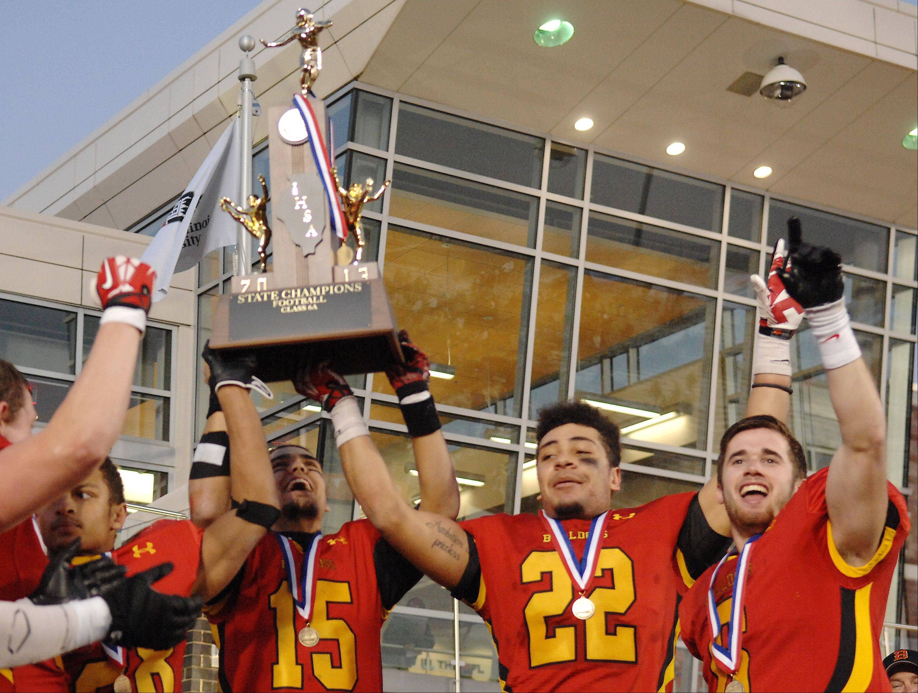 The Batavia captains hoist the championship trophy following Saturday's 6A championship game in DeKalb.