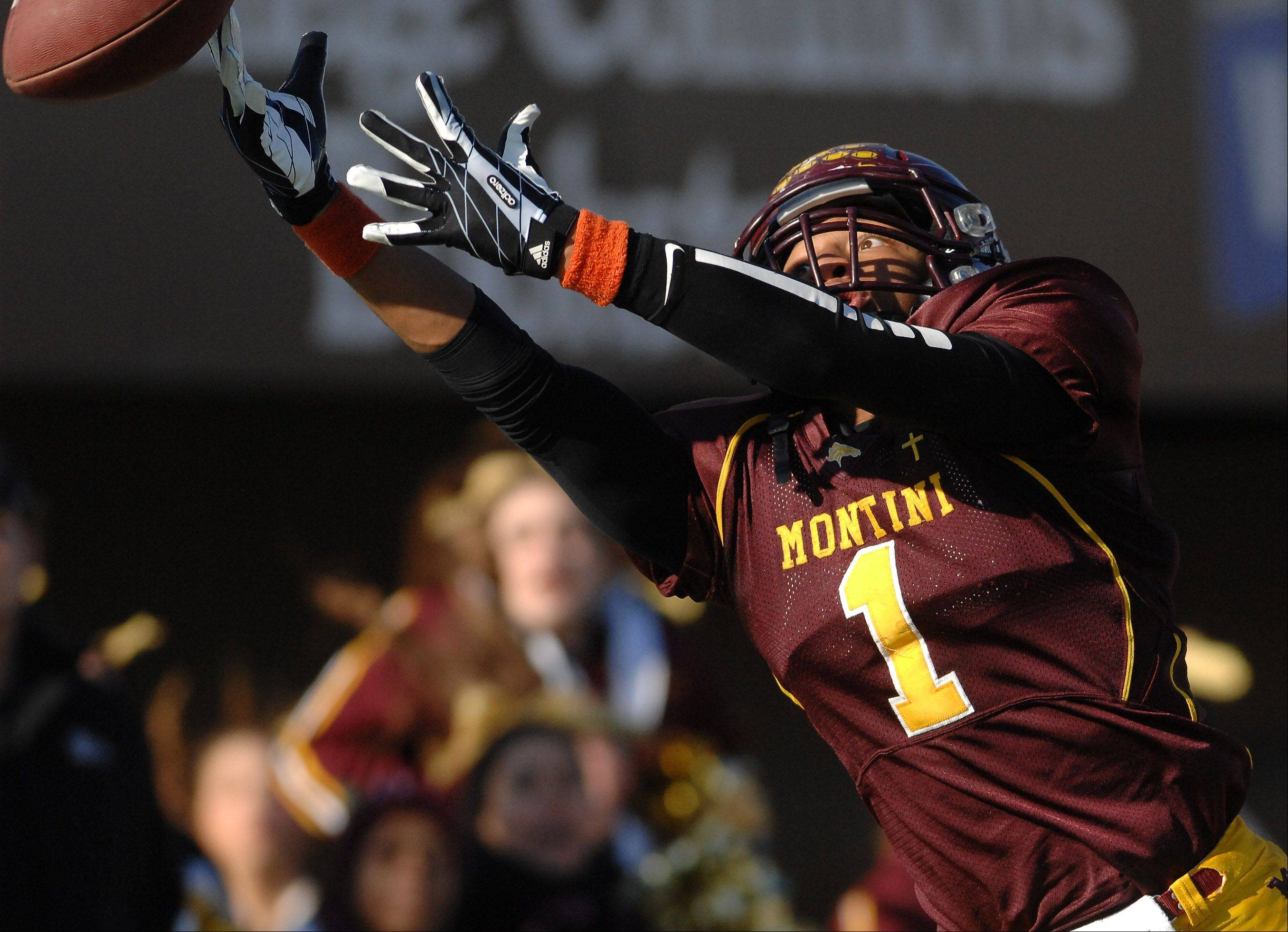 Montini's Leon Thornton III (1) just misses a catch in the end zone during Saturday's 5A championship game in DeKalb.