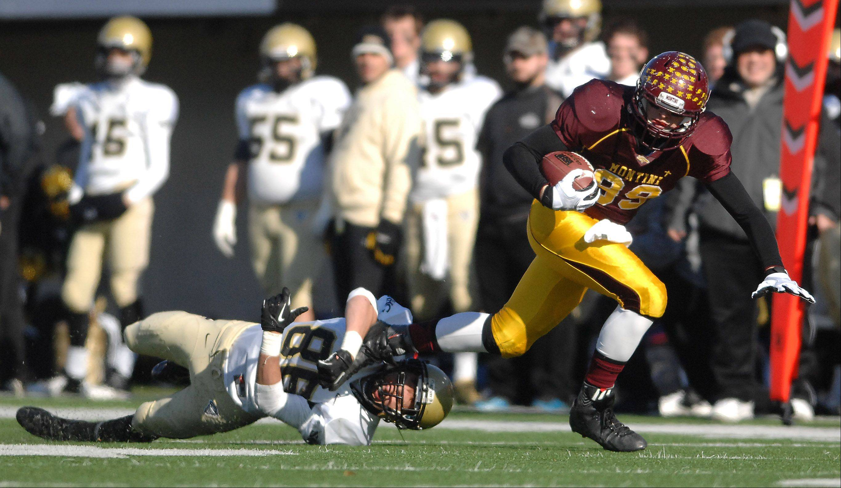 Montini's Matthew Brachmann (89) slips out of a tackle attempt during Saturday's 5A championship game in DeKalb.