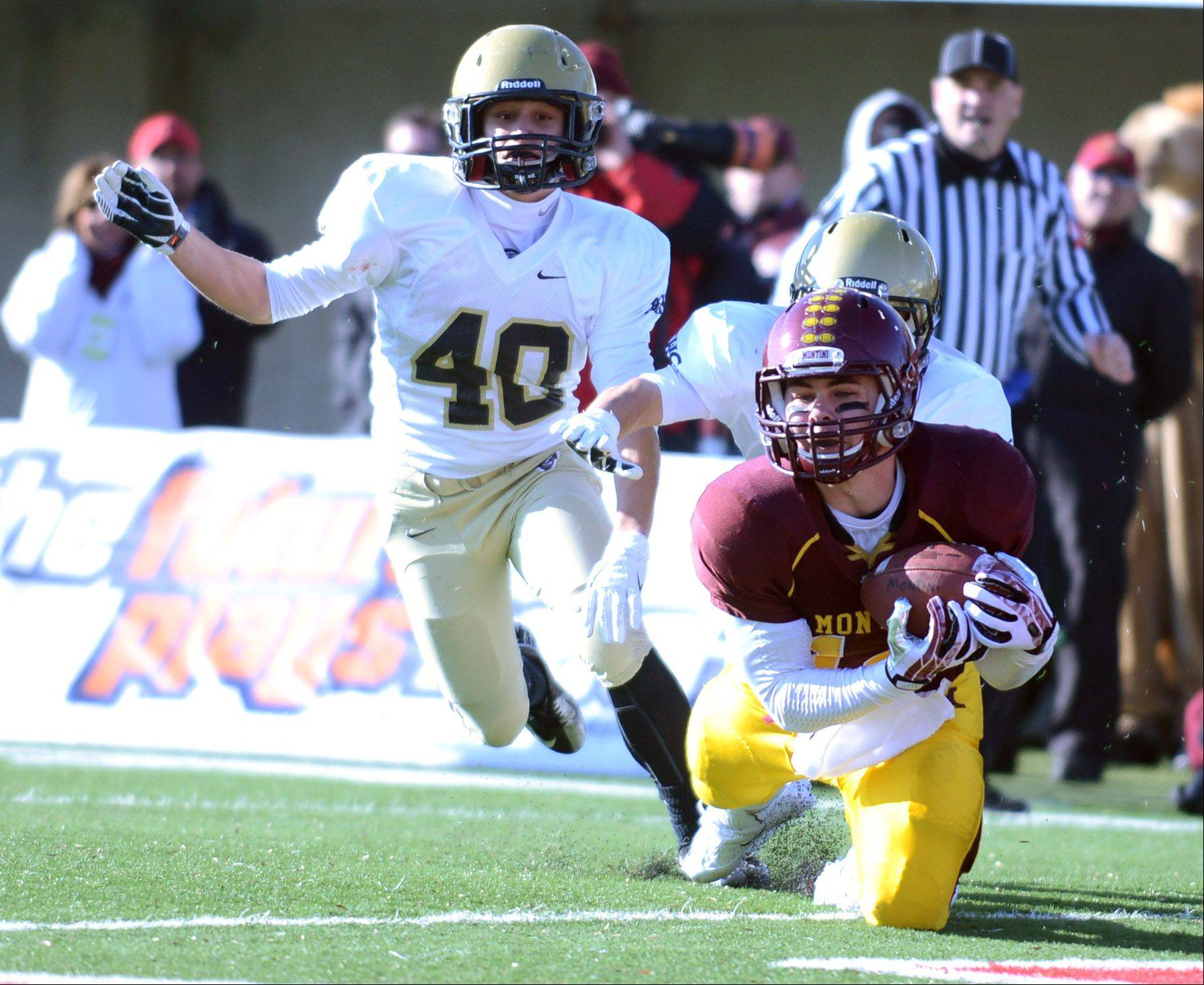 Montini's Connor Costello (14) hauls in a first-quarter touchdown pass against Sacred Heart-Griffin during Saturday's 5A championship game in DeKalb.
