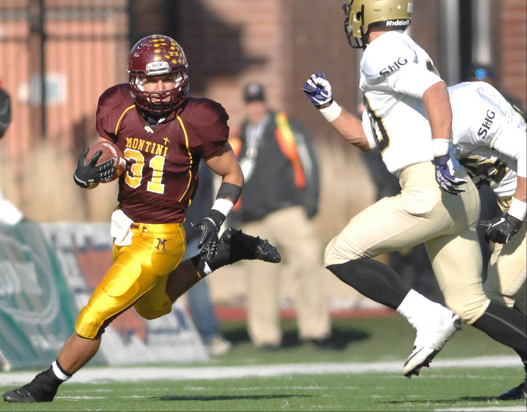 Montini's Nicholas Italia (31) breaks to the outside against Sacred Heart-Griffin during Saturday's 5A championship game in DeKalb.