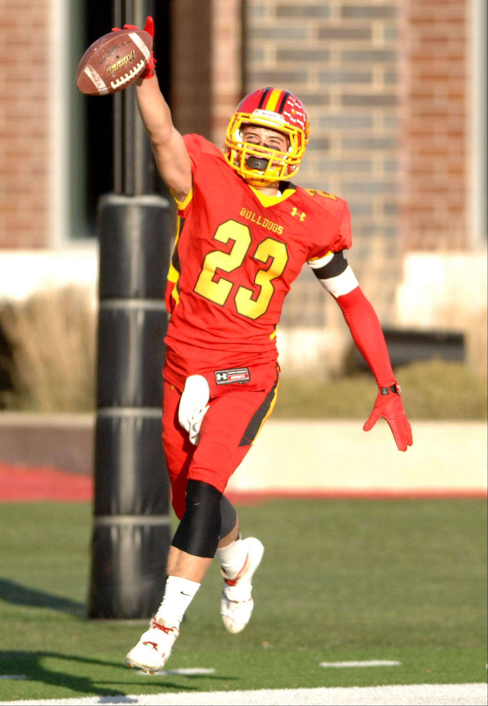 Batavia's Michael Moffatt (23) celebrates his long first quarter touchdown reception during Saturday's 6A championship game in DeKalb.