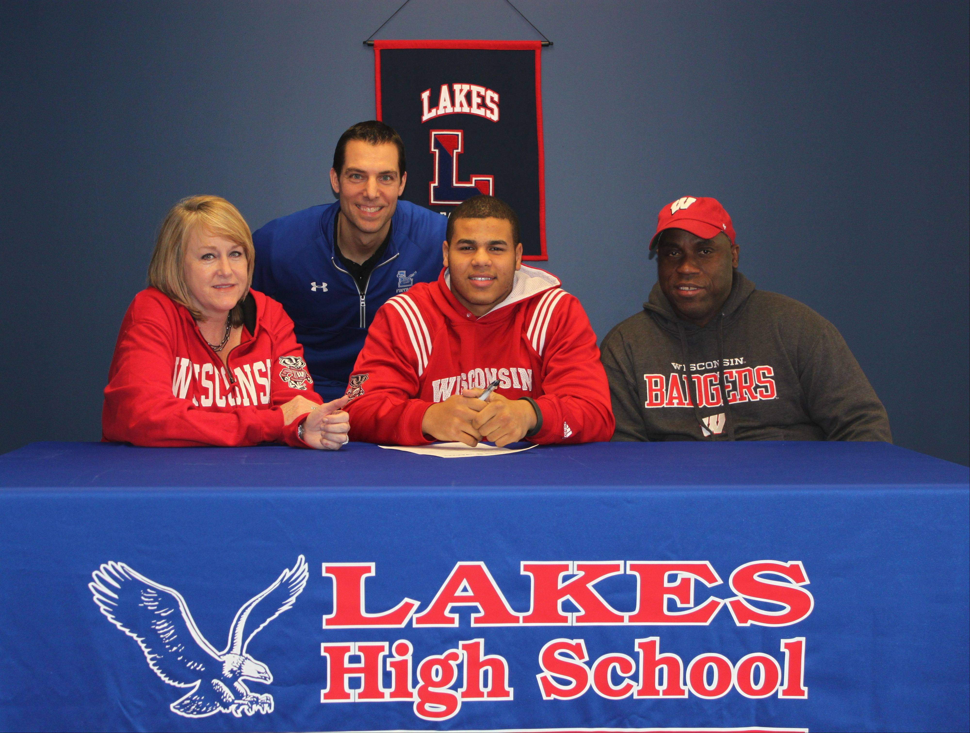 Lake's TJ Edwards, flanked by his parents and backed by coach Luke Mertens, signed his letter of intent with Wisconson on Wednesday.