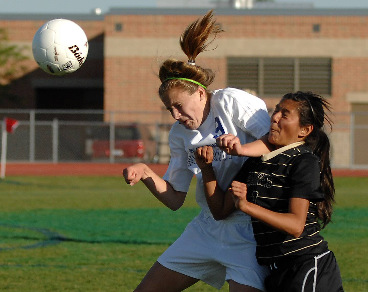 St. Charles North's Alyssa Brandt, left, not only is an excellent soccer player but carries a 5.6 GPA.