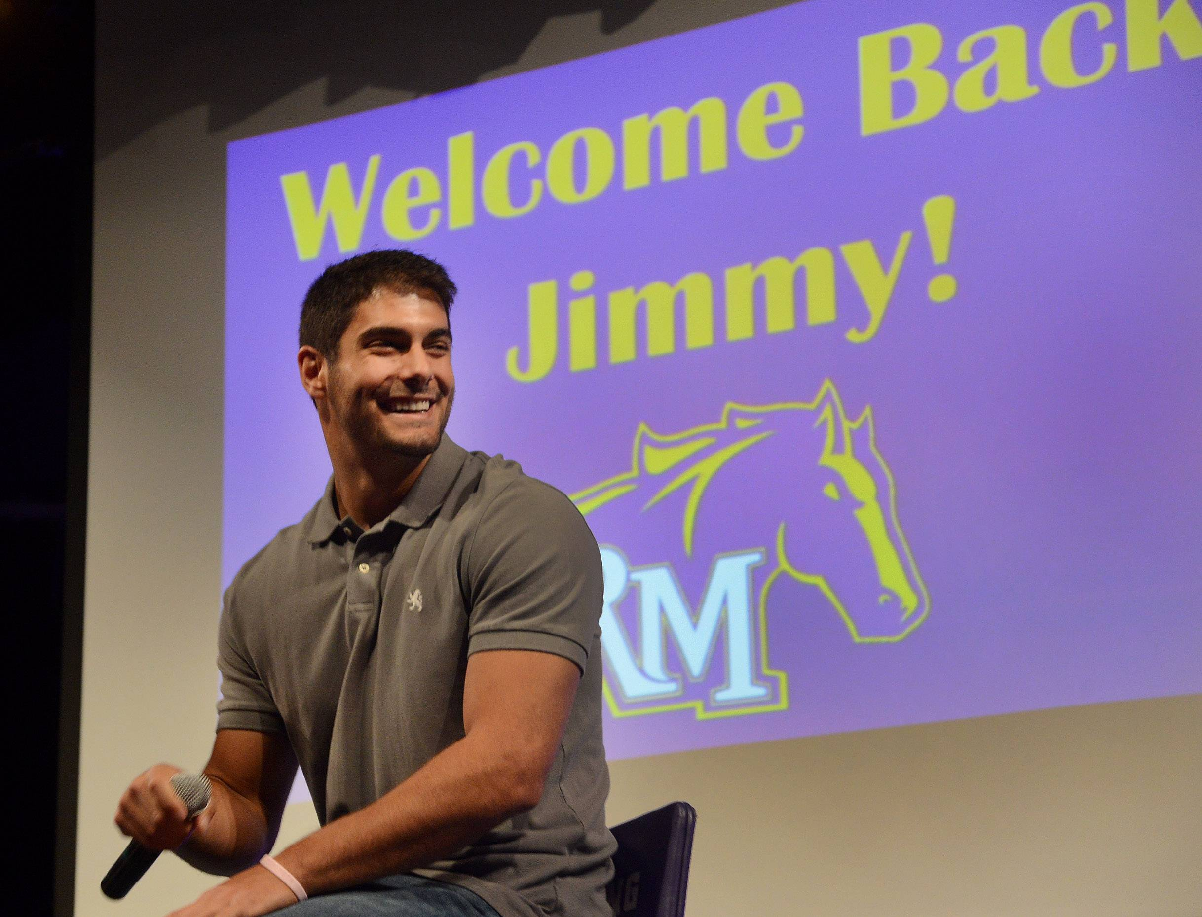 NFL quarterback prospect Jimmy Garoppolo returned to Rolling Meadows High School on Thursday morning to reunite with former coaches and players and to talk to students.