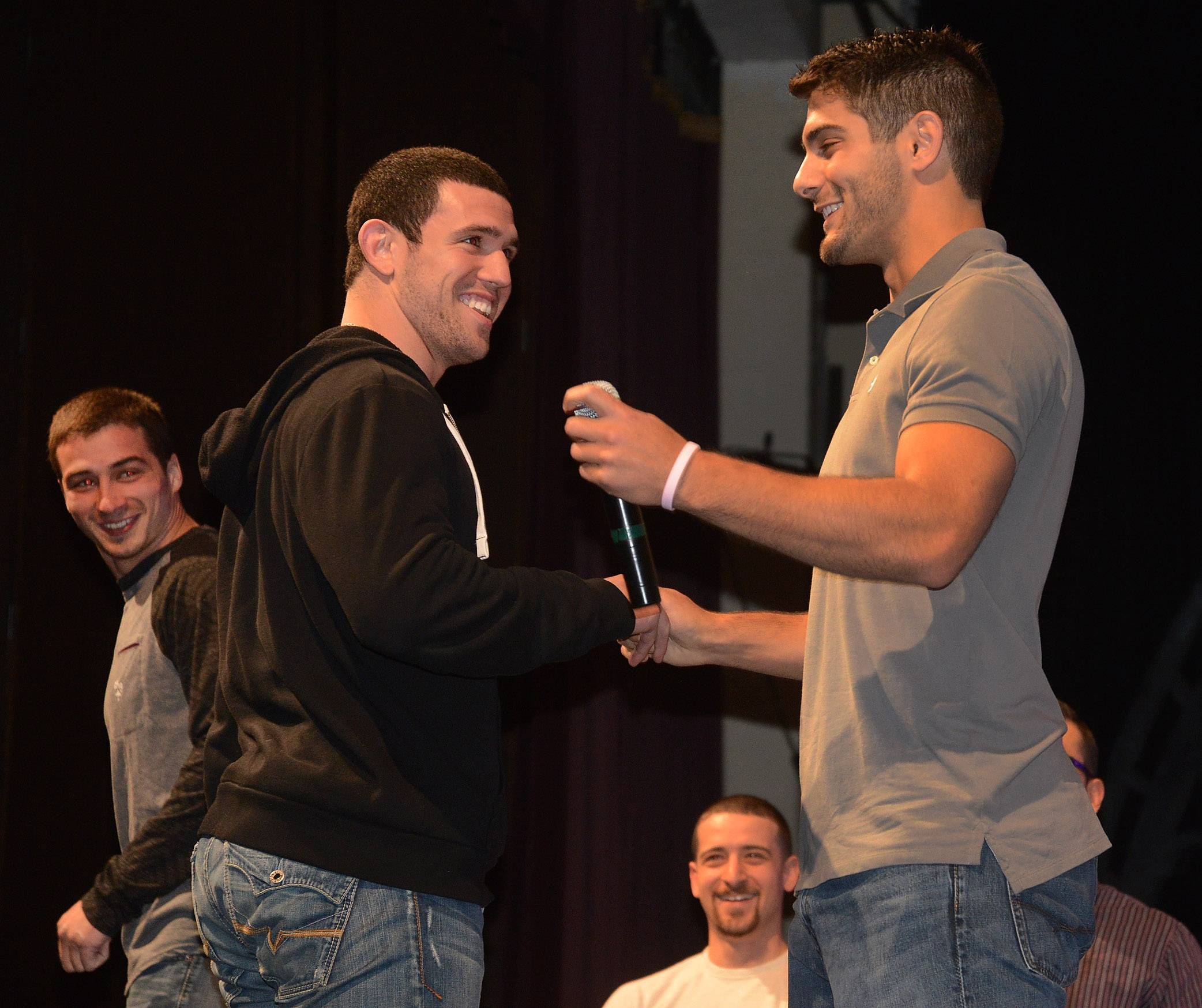 NFL quarterback prospect Jimmy Garoppolo returned to Rolling Meadows High School on Thursday to reunite with former coaches and players and to talk to students. Here he shakes hands with former teammate Tony Taibi.