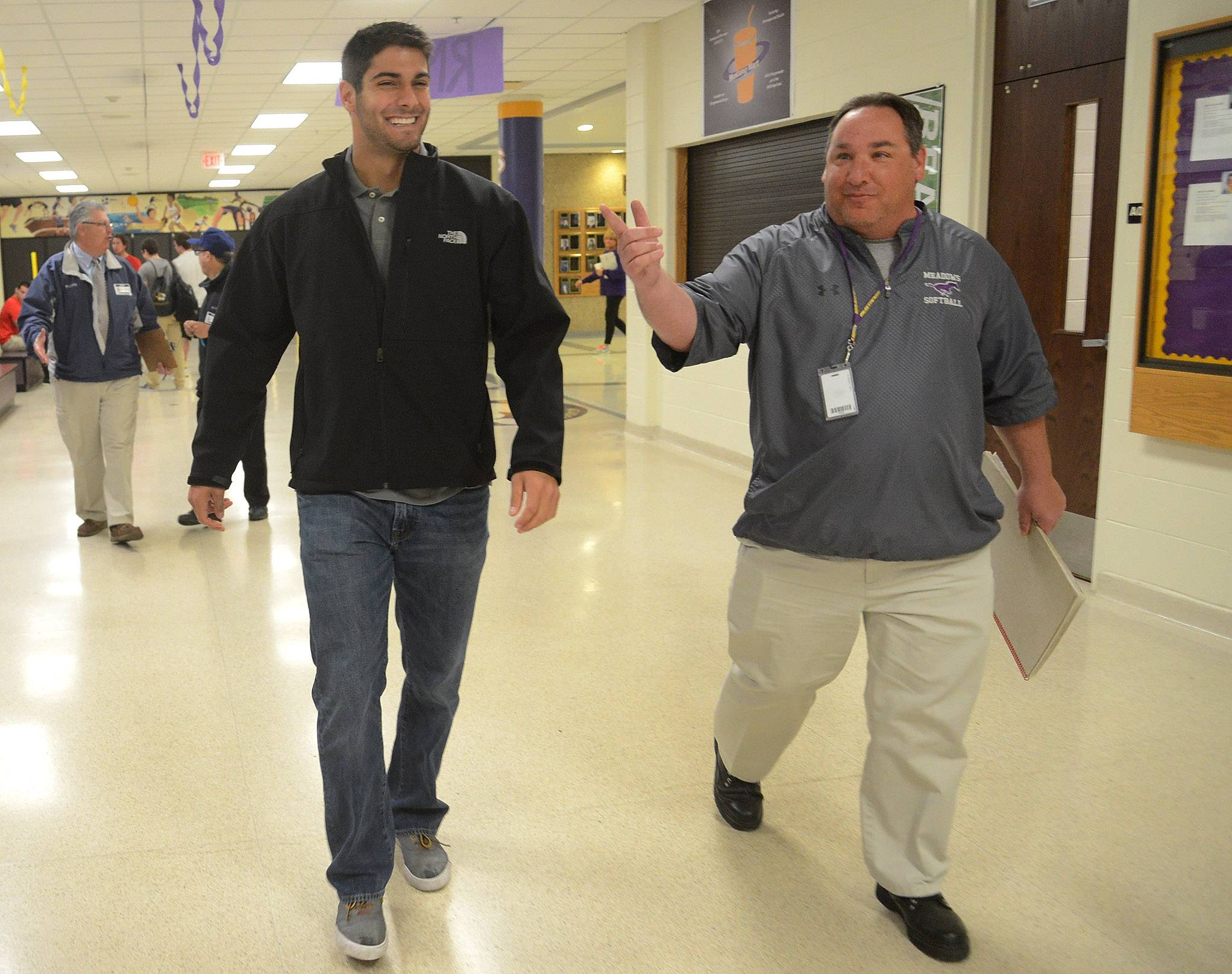 NFL quarterback prospect Jimmy Garoppolo returns to Rolling Meadows High School to reunite with former coaches and players and to talk to students. Here, coach Tony Wolanski walks with Garoppolo to the auditorium.