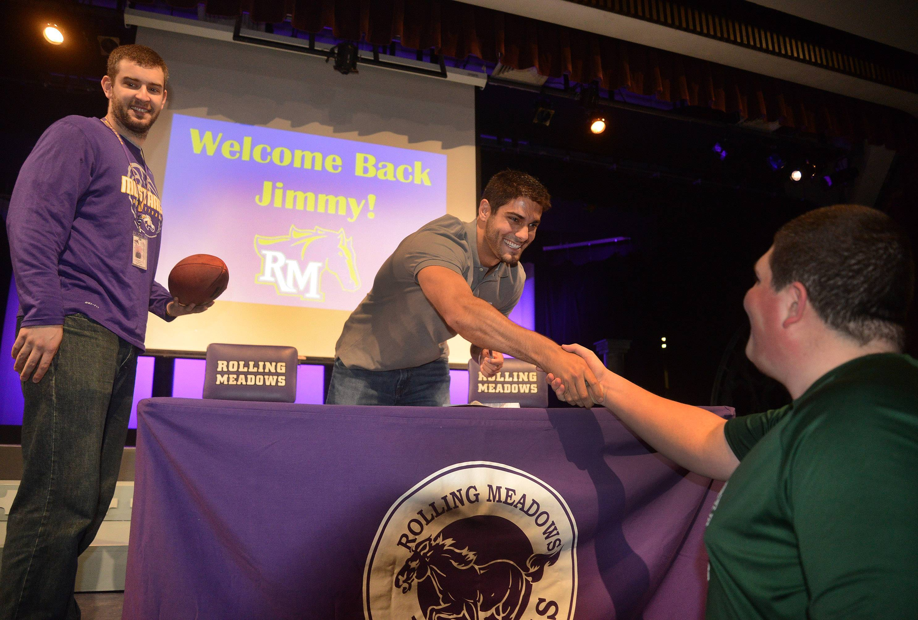NFL quarterback prospect Jimmy Garoppolo returned to Rolling Meadows High School on Thursday to reunite with former coaches and players and to talk to students.