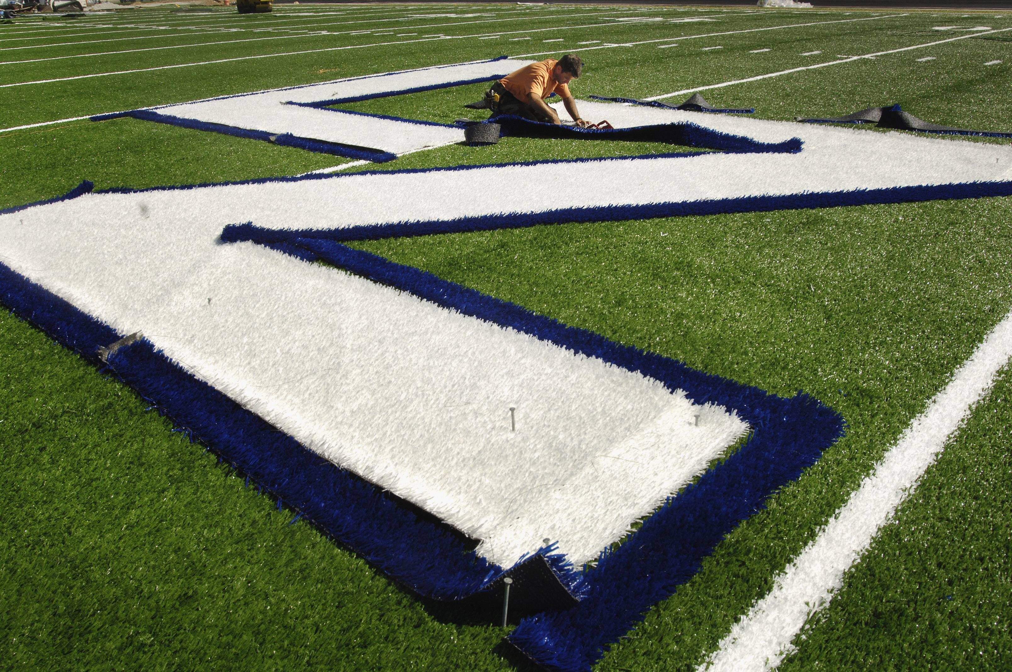 Crews installed a synthetic playing field at Lake Zurich High's football stadium in 2005. Lake Zurich Unit District 95 board members agreed Thursday to replace what they say is a worn-out surface.