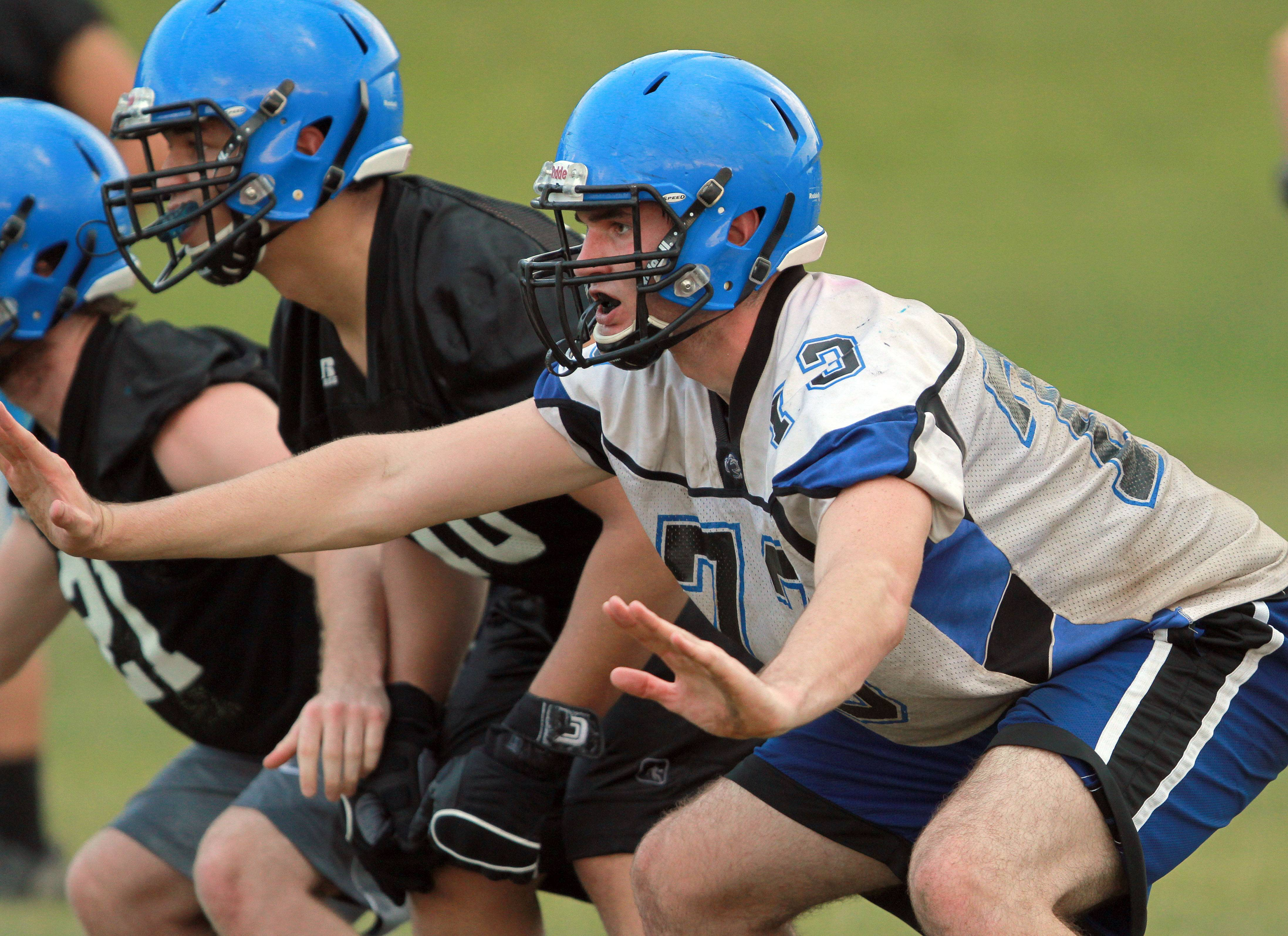 Zach Wallace goes through drills during football practice Monday at Lake Zurich High School.