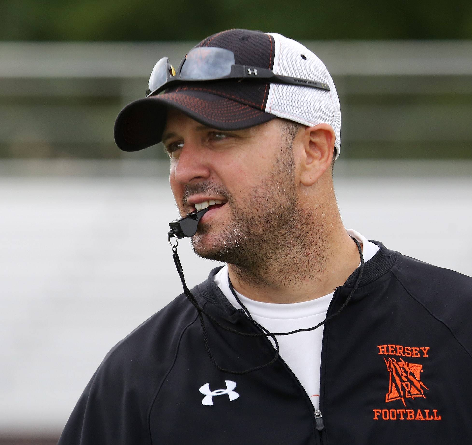 Football coach Joe Pardun watches his team during drills on the first day of football practice at Hersey High School on Monday. Pardun is starting his first year leading the team after several years as an assistant.