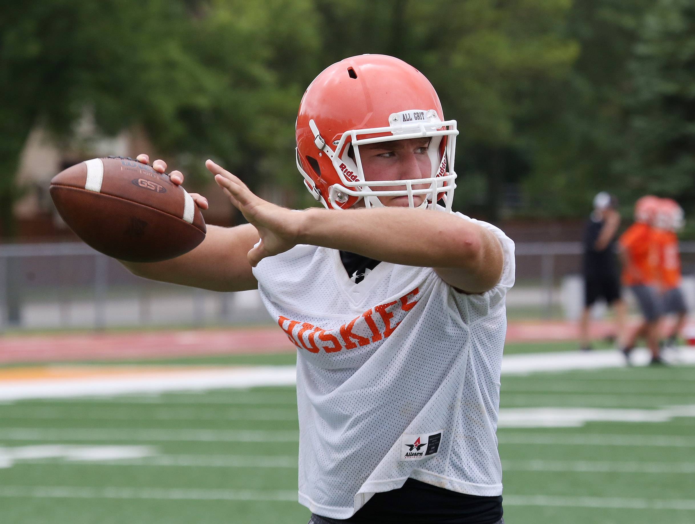 Quarterback Joe Caputo throws the ball during the first day of football practice at Hersey High School on Monday.