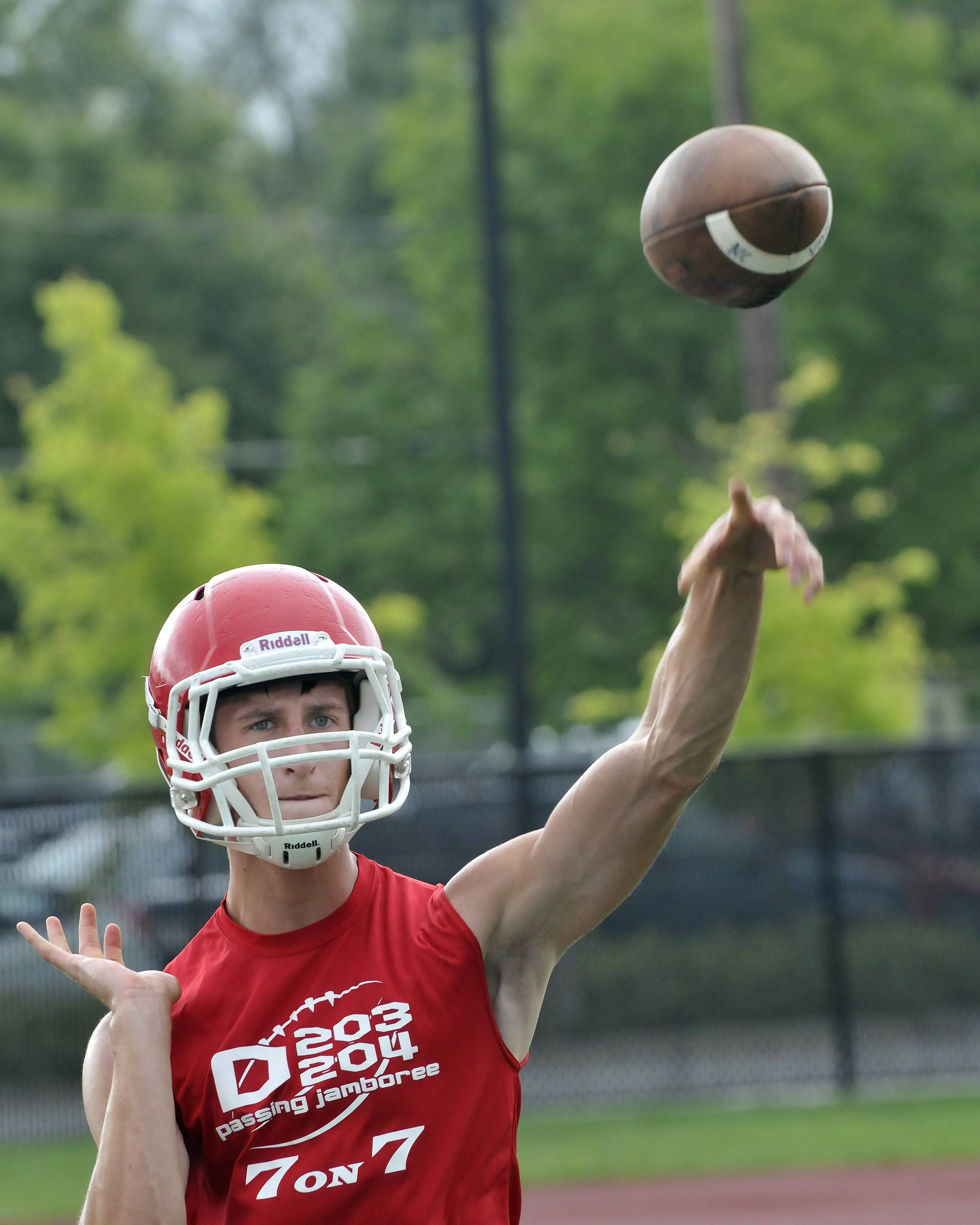 Naperville Central High School's football team works Monday out on the first official day of practice. Left-handed starting Quarterback David Wesolowski tosses some practice throws.