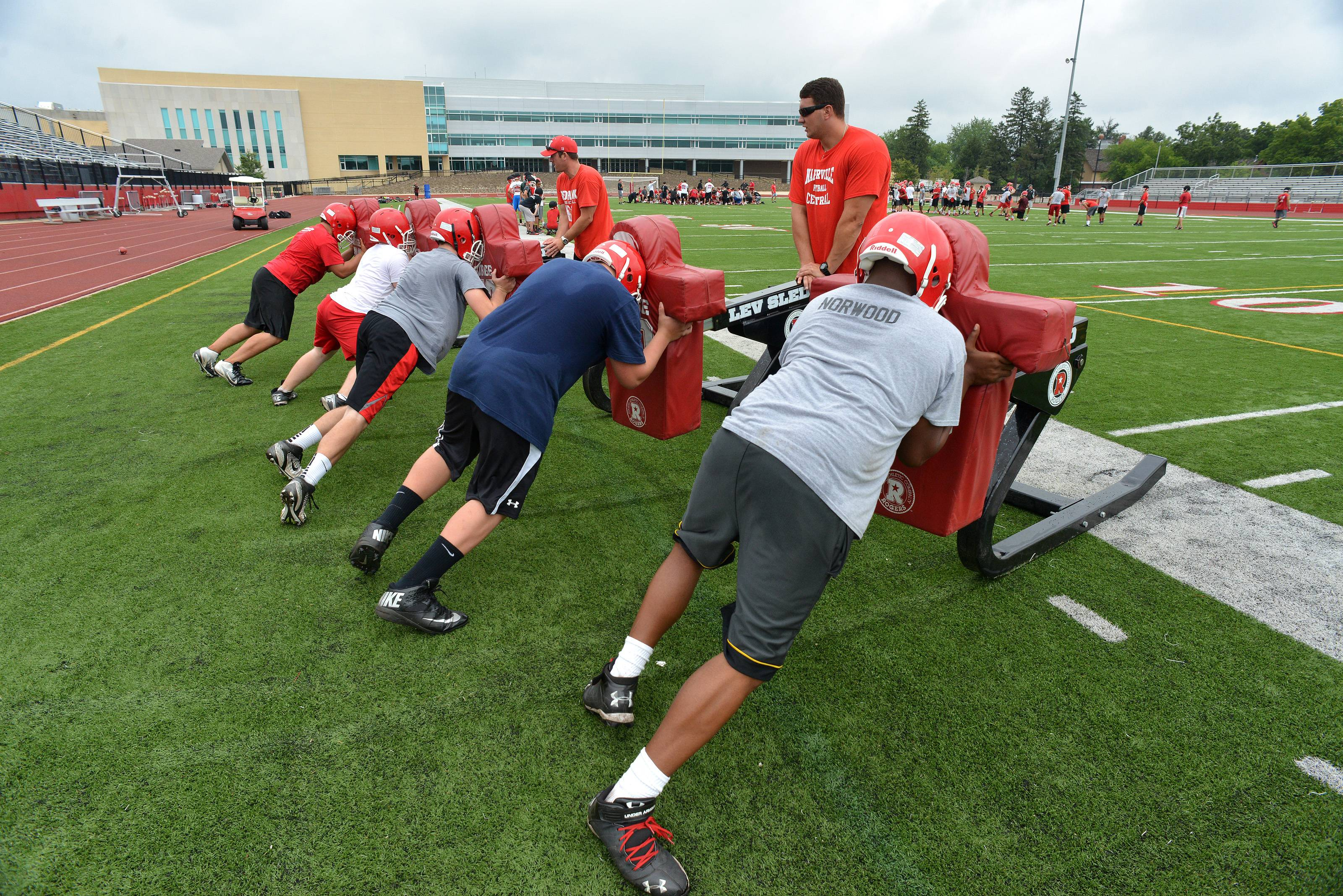 Naperville Central High School's linemen work on the sled.