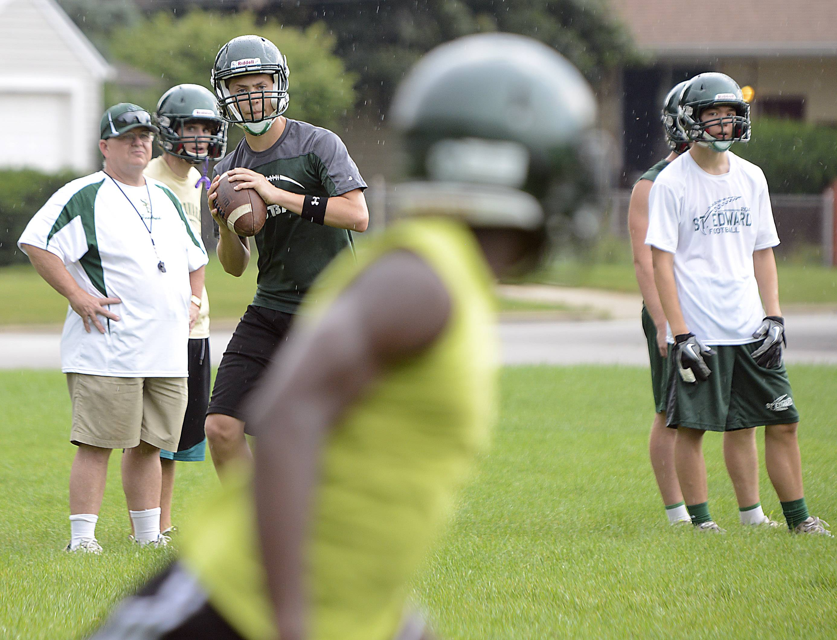 Quarterback Joe Mullen looks for Dwayne Allen during St. Edward High School football practice Monday.