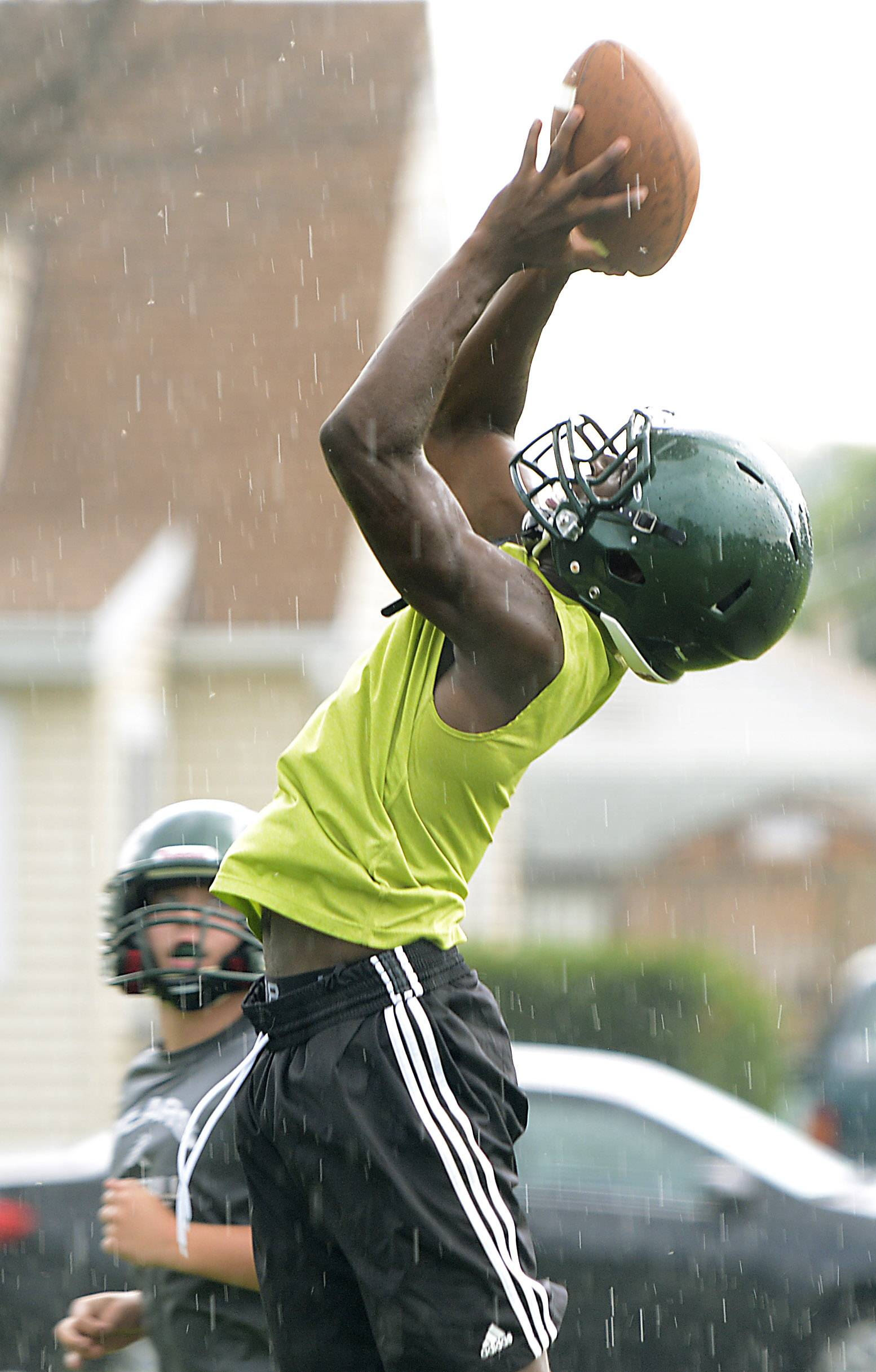 Dwayne Allen stretches for a pass during St. Edward High School football practice Monday.