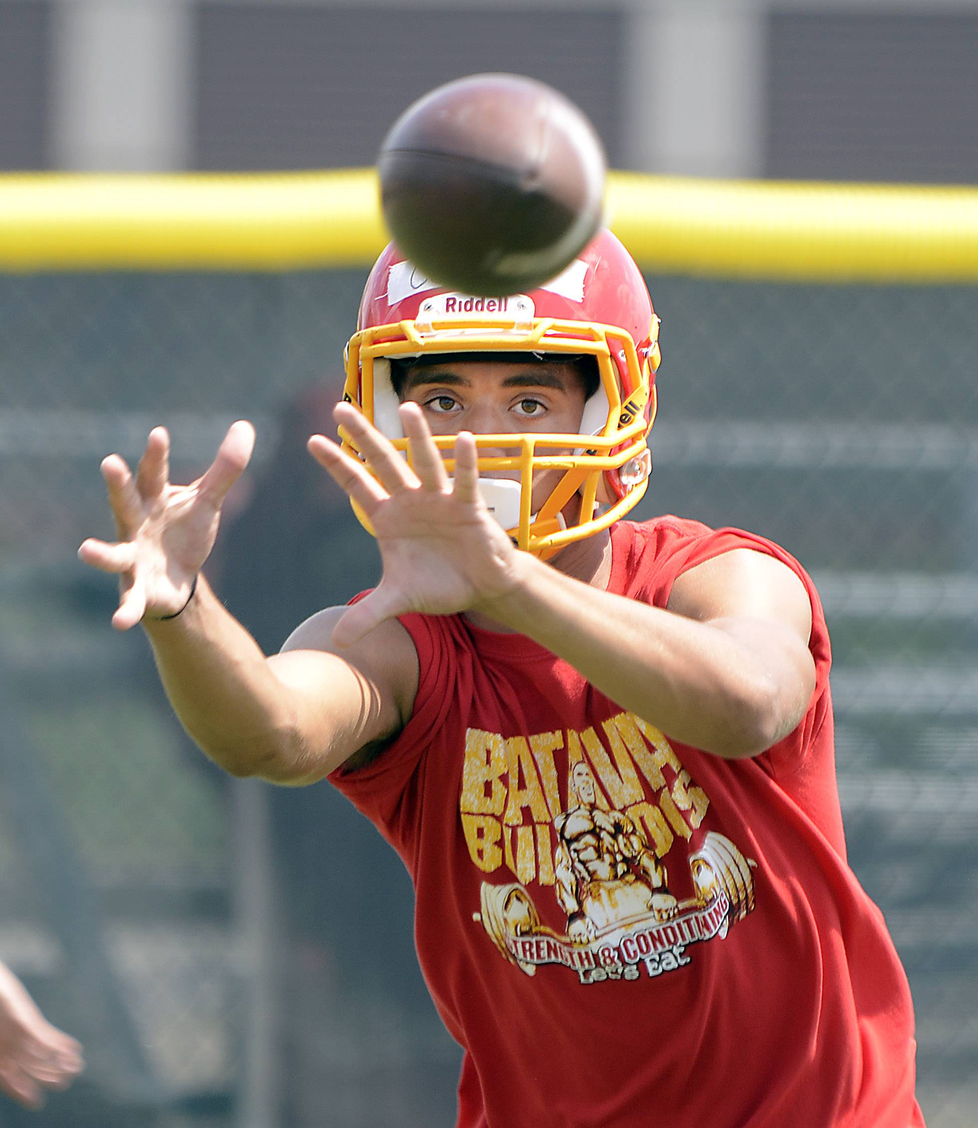 Blake Crowder receives a pass during Batavia High School football practice Monday.