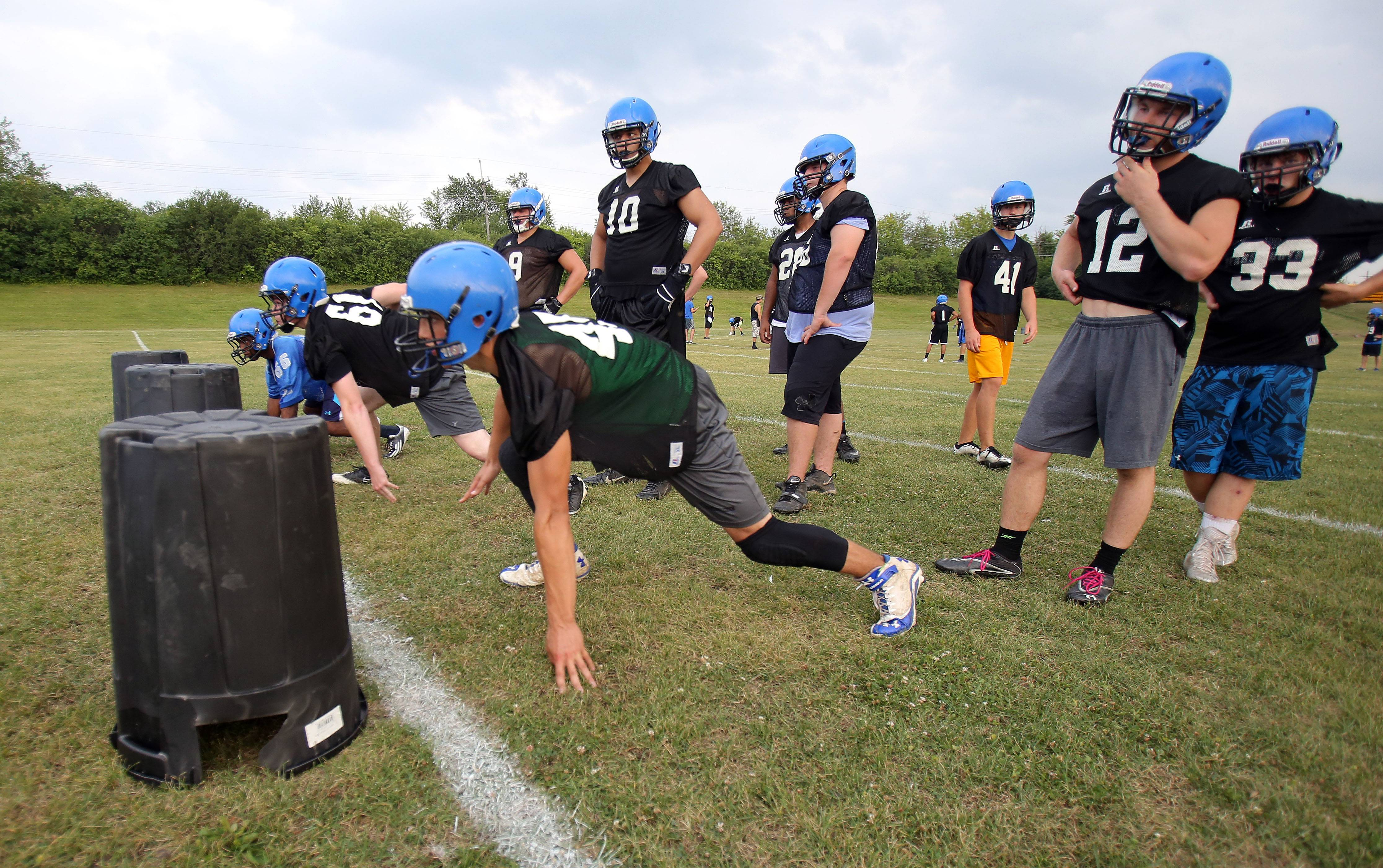 Players go through drills during football practice Monday at Lake Zurich.