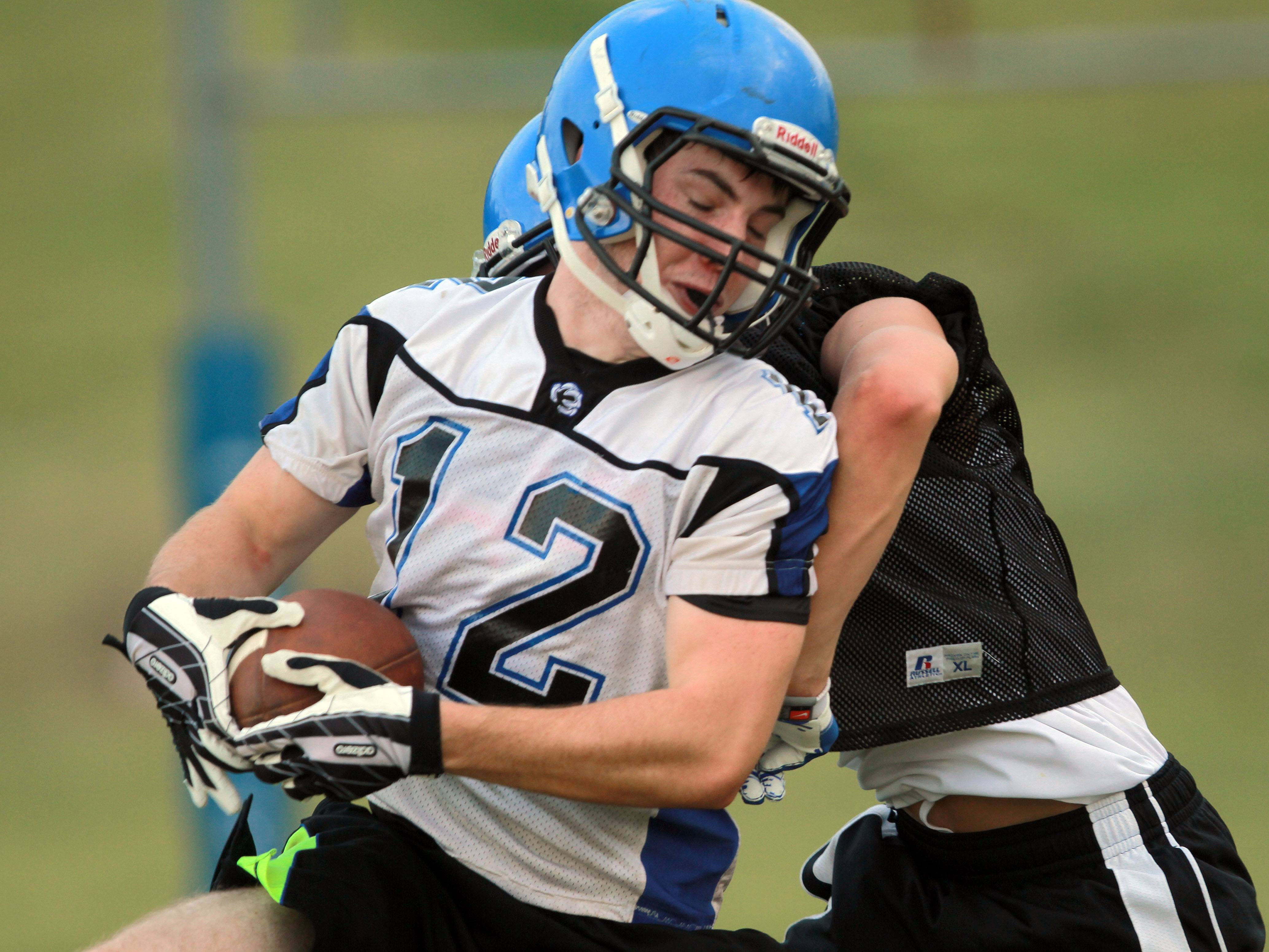 Andy Hughes makes a catch during football practice Monday at Lake Zurich.